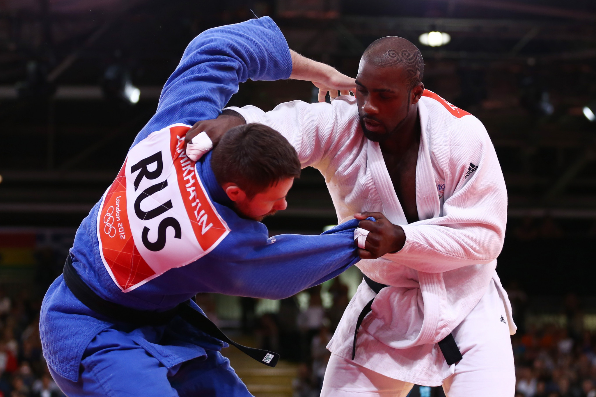 Teddy Riner of France (white) and Alexander Mikhaylin of Russia compete in the Men's +100 kg Judo on Day 7 of the London 2012 Olympic Games ©Getty Images