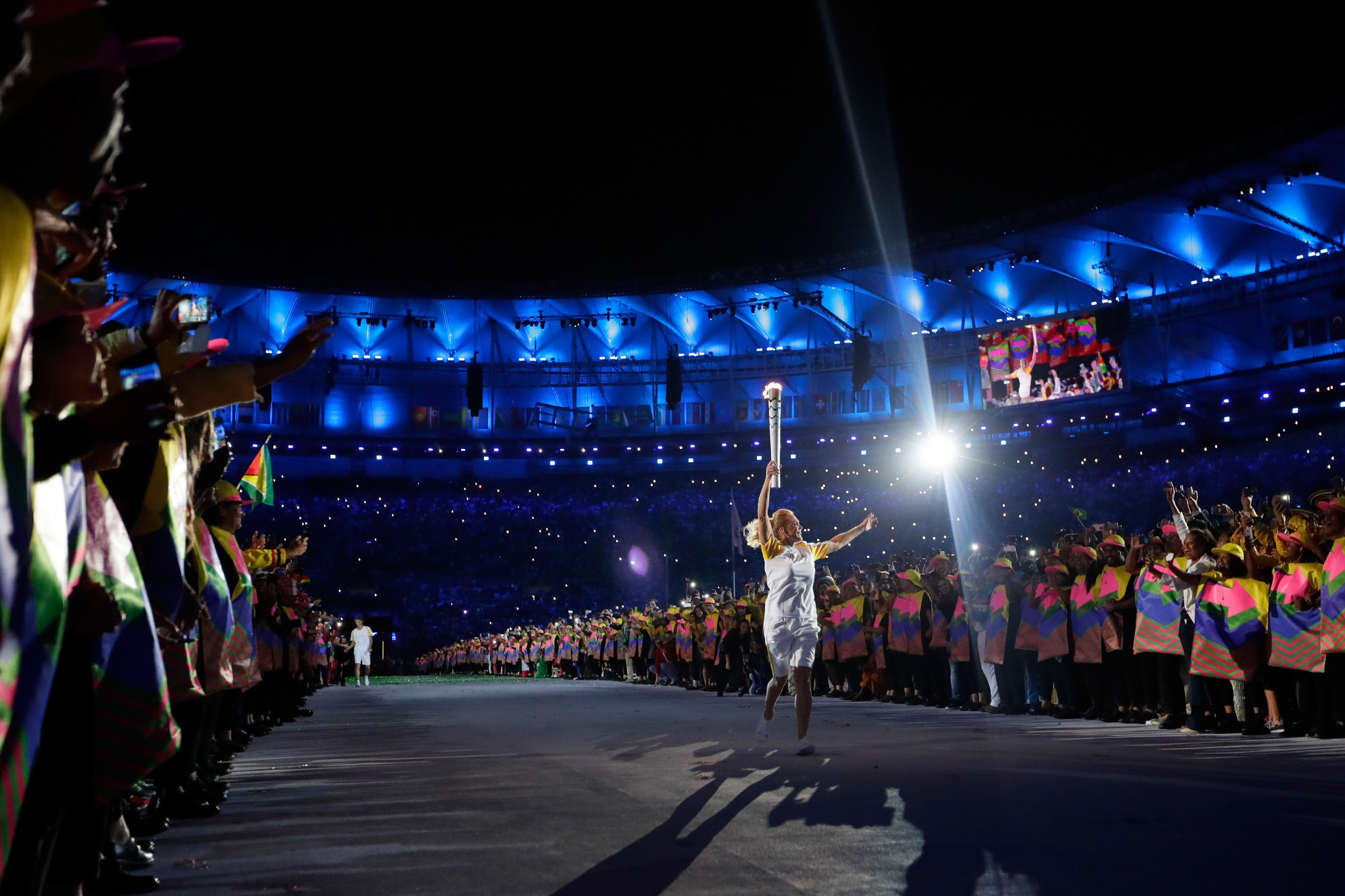 Hortencia Marcari carries the Olympic torch during the Opening Ceremony of the Rio 2016 Olympic Games ©Getty Images