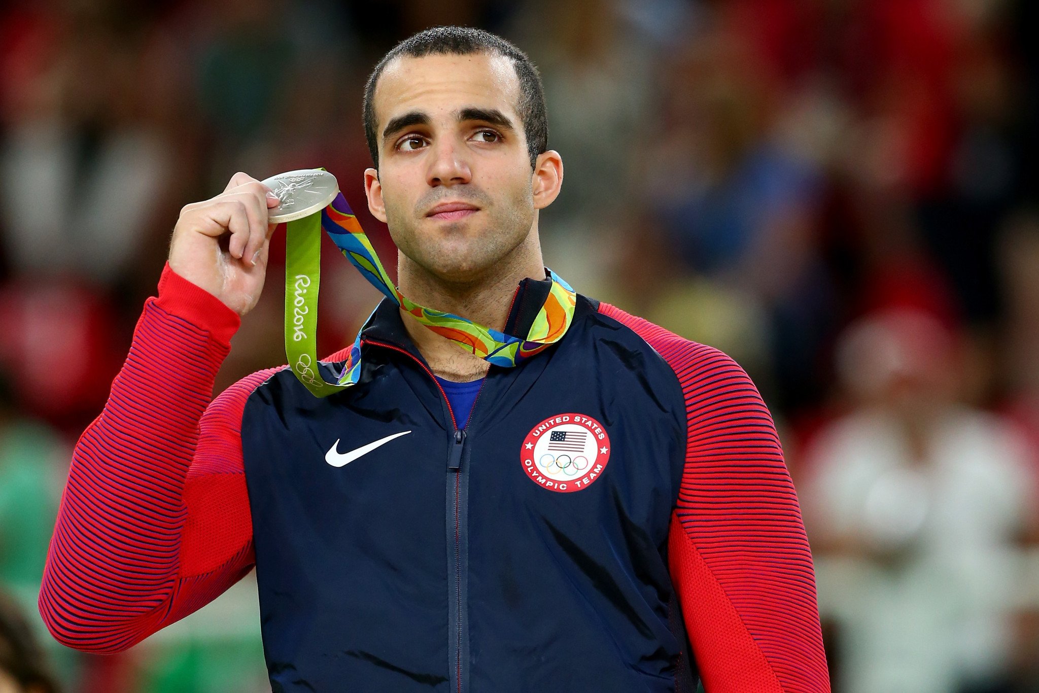 Silver medalist Danell Leyva of the United States celebrates on the podium at the medal ceremony for the Horizontal Bar on Day 11 of the Rio 2016 Olympic Games ©Getty Images