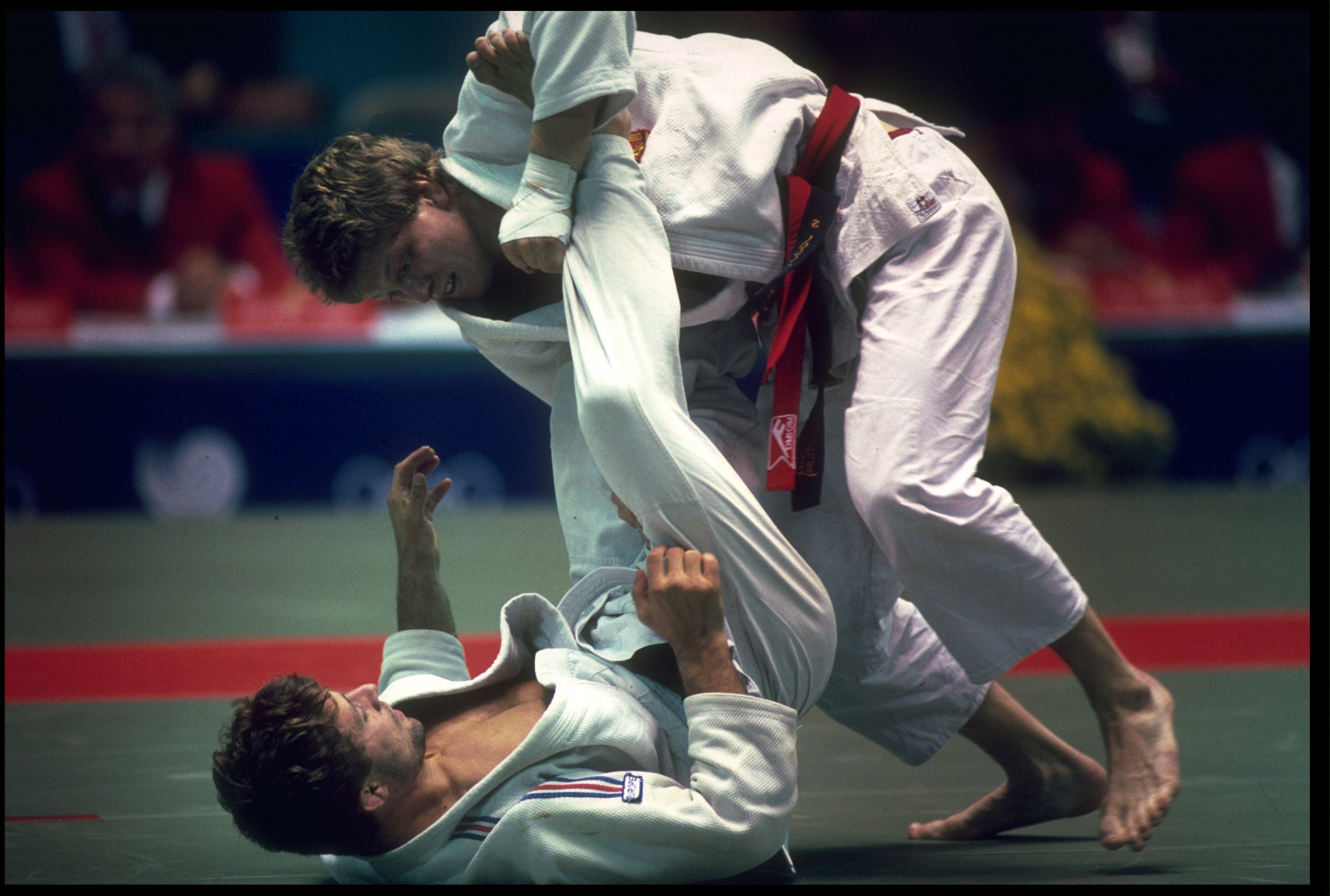 Marc Alexandre of France knocks Sven Loll of East Germany to the mat during the final of the mens lightweight judo competition at the 1988 Seoul Olympics ©Getty Images