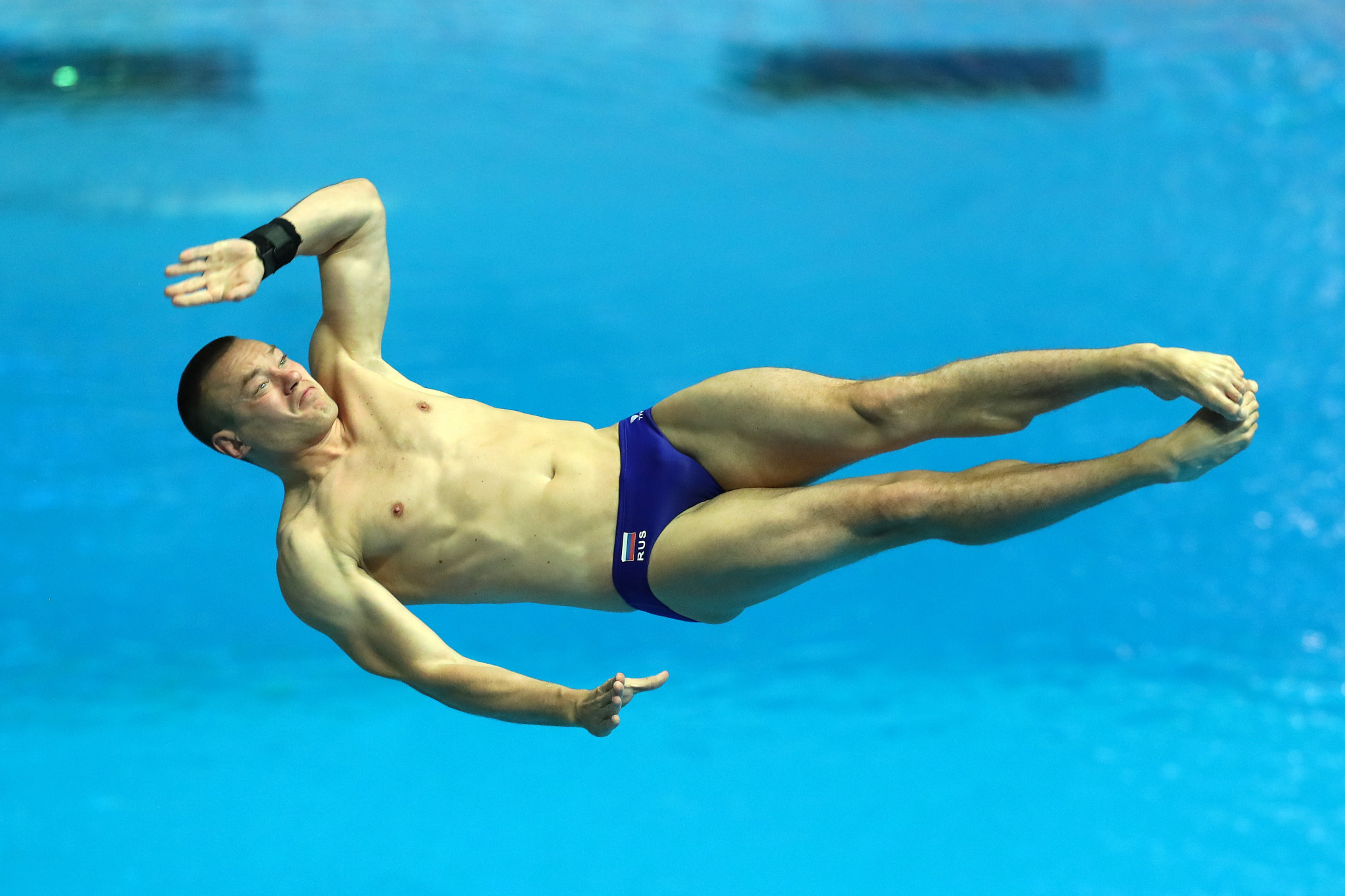 Evgenii Kuznetsov followed up the mixed synchro success with victory in the men's 3 metre springboard ©Getty Images