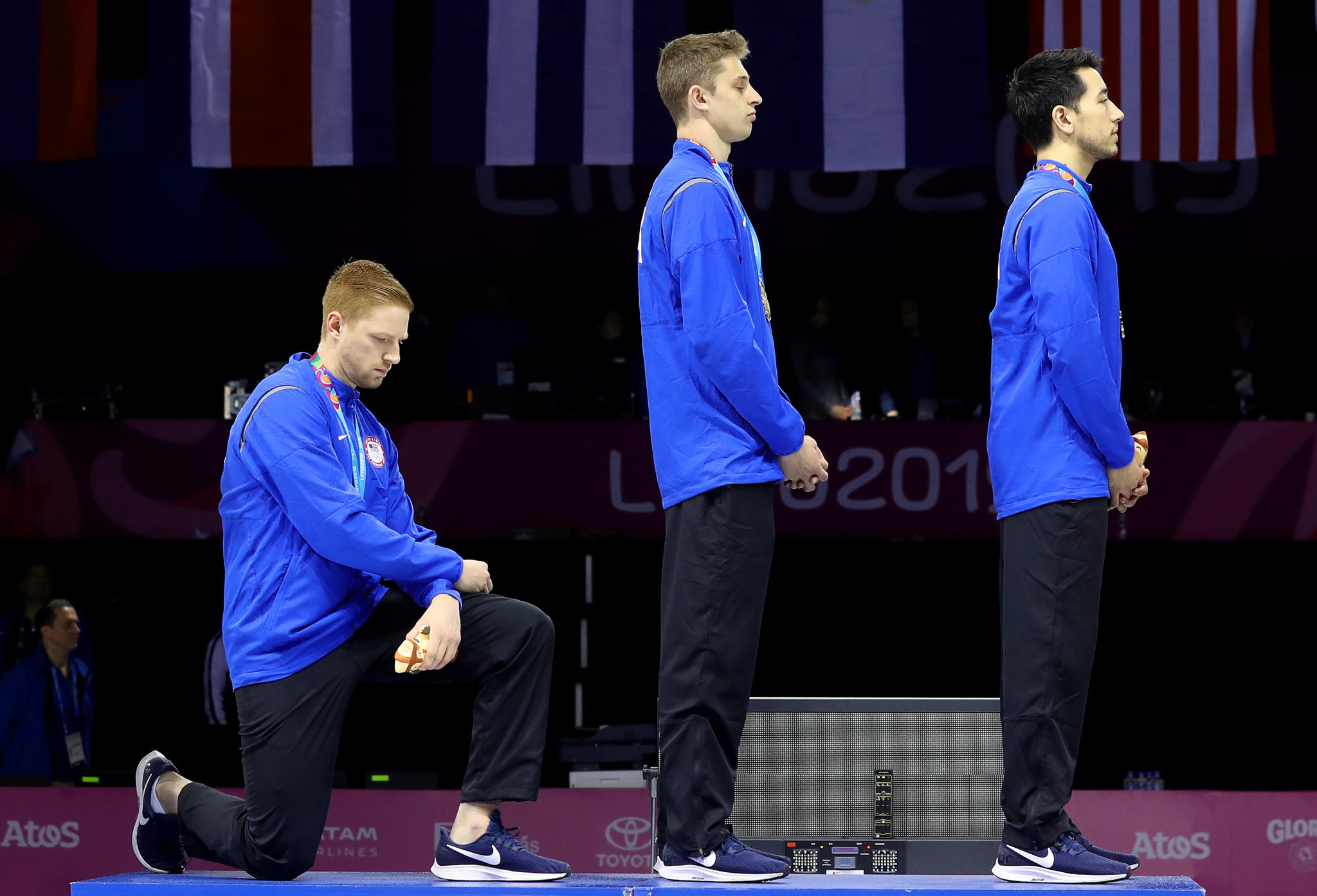 Race Imboden took a knee during the men's team foil medal ceremony ©Getty Images