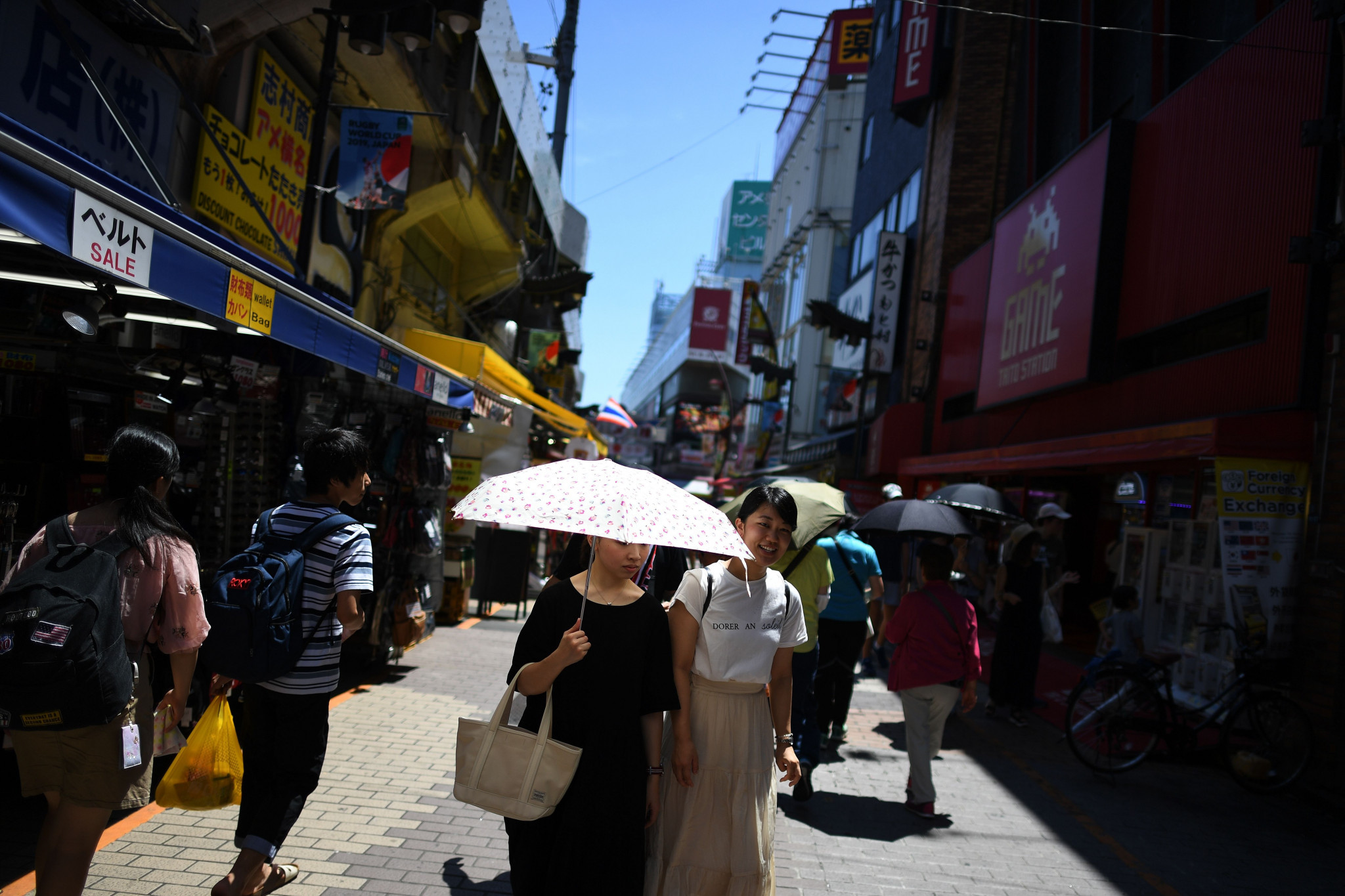 Japanese residents have used umbrellas to help shield themselves from the heat as temperatures soared beyond 30 Celsius, causing tens of deaths and thousands of people to be taken to hospital ©Getty Images