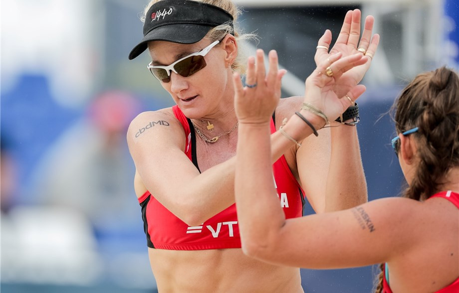 Birthday girl Walsh Jennings and partner Sweat top pool at FIVB Beach World Tour event in Moscow