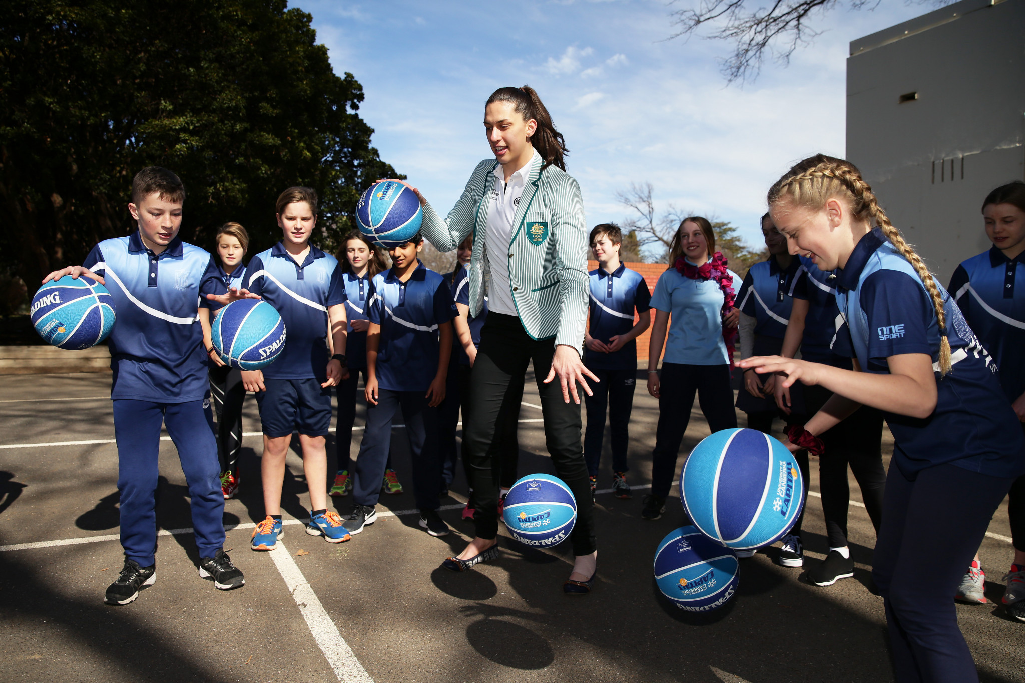 Australian basketballer Marianna Tolo joined students in Canberra to announce the extension of Olympics Unleashed at an event attended by the Deputy Chief Minister of the Australian Capital Territory Yvette Berry ©Getty Images