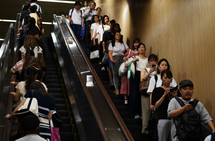 Commuters in the Tokyo Metro system this year – not generally a place where those in wheelchairs are seen ©Getty Images