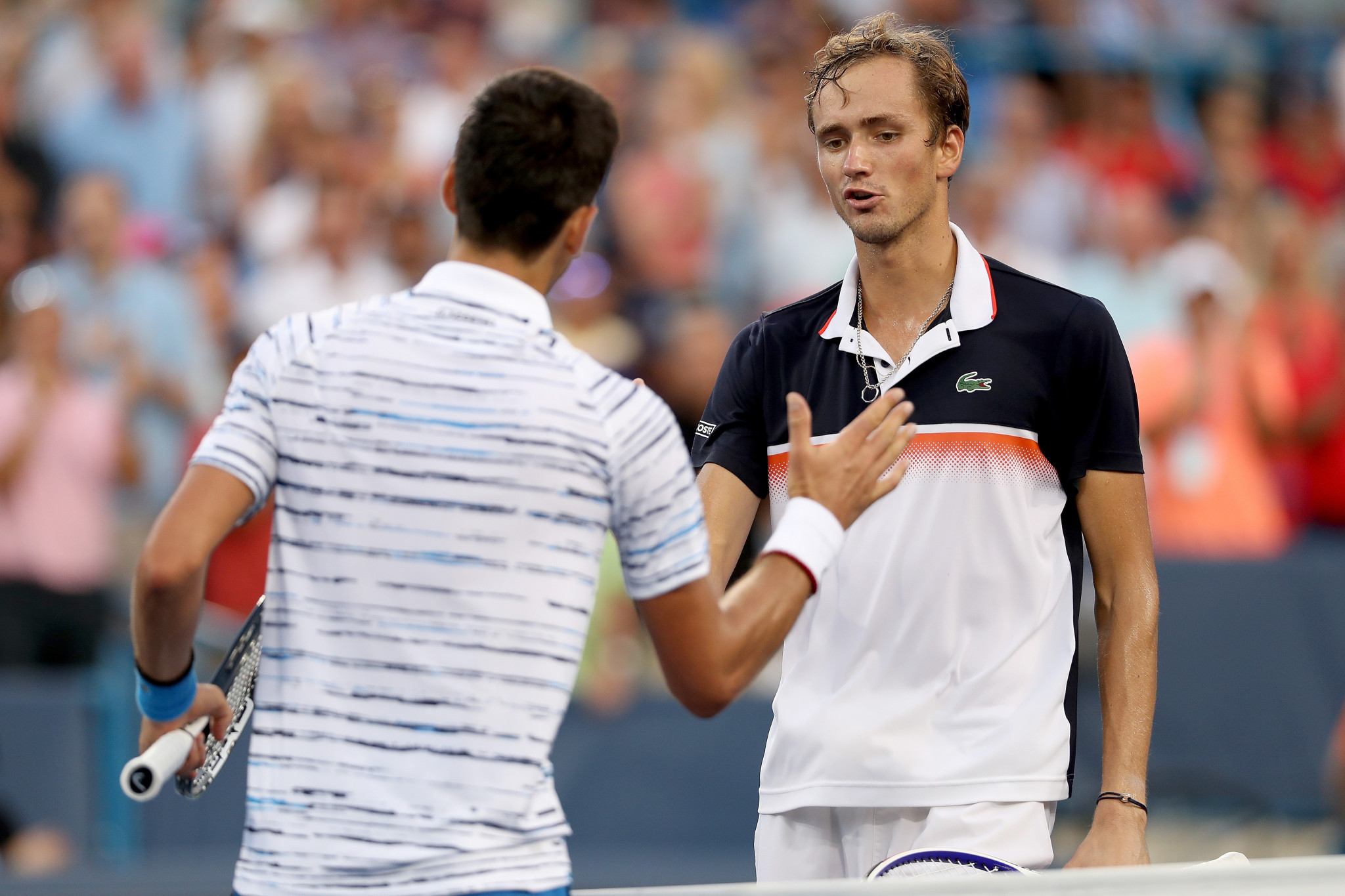 Serbian Novak Djokovic congratulates Daniil Medvedev of Russia after losing their semi-final clash ©Getty Images