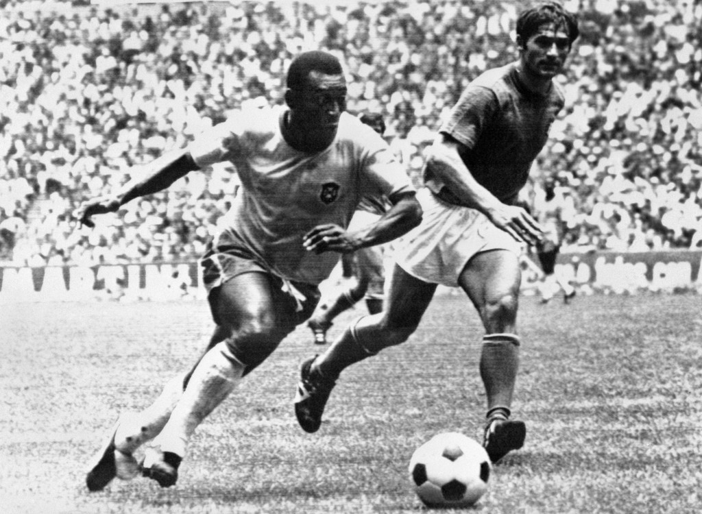 Pele in full flight during Brazil's victory over Italy in the 1970 World Cup final - Lomu had a similar irresistible blend of power and speed ©Getty Images
