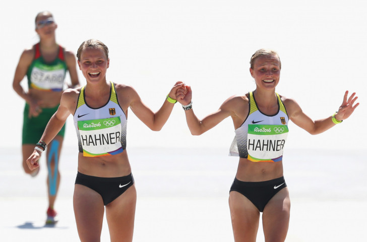 Germany's twins, Lisa and Anna Hahner, hold hands at the finish of the Rio 2016 women's marathon ©Getty Images