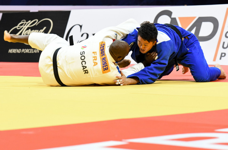 Rio 2016 champion Teddy Riner and Japan's Hisayoshi Harasawa in action during last month's Grand Prix final in Montreal ©IJF