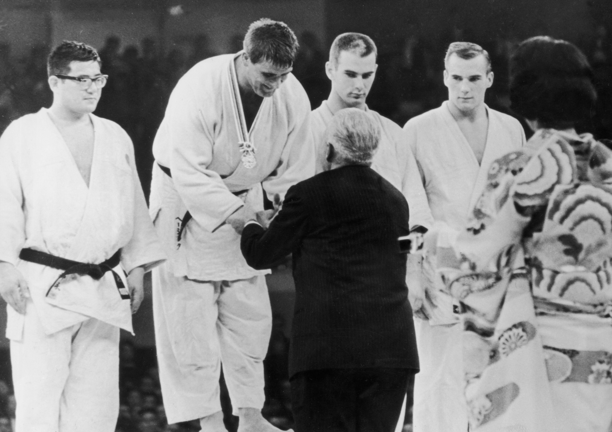 Glahn, far right, collecting bronze at the first ever Olympic judo competition at the 1964 Games ©Getty Images