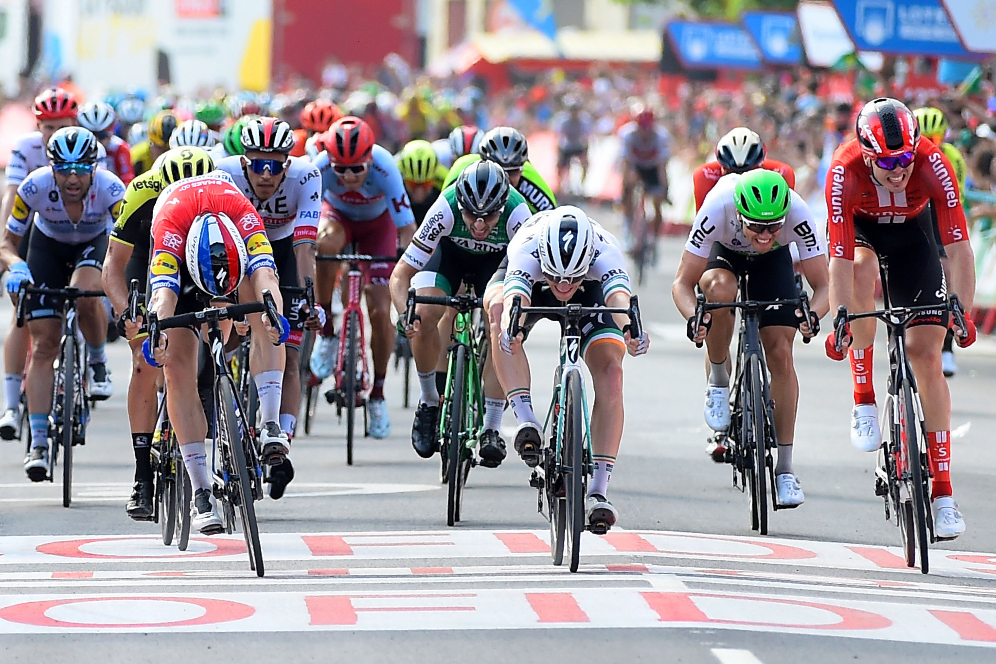 Jakobsen earns narrow victory to win first Grand Tour stage at Vuelta a España