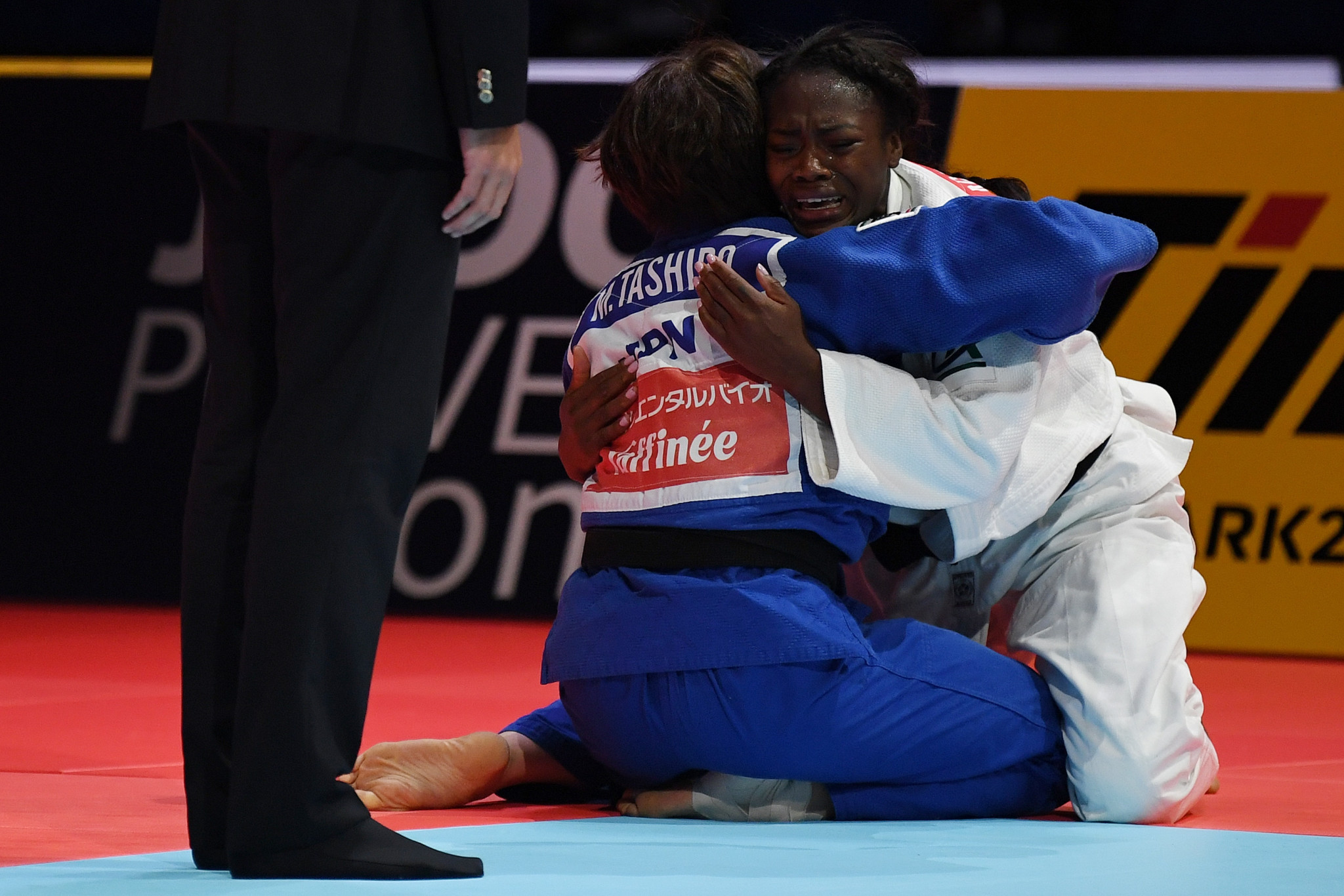 The two friends embrace after Agbegnenou won her fourth World Championship ©Getty Images