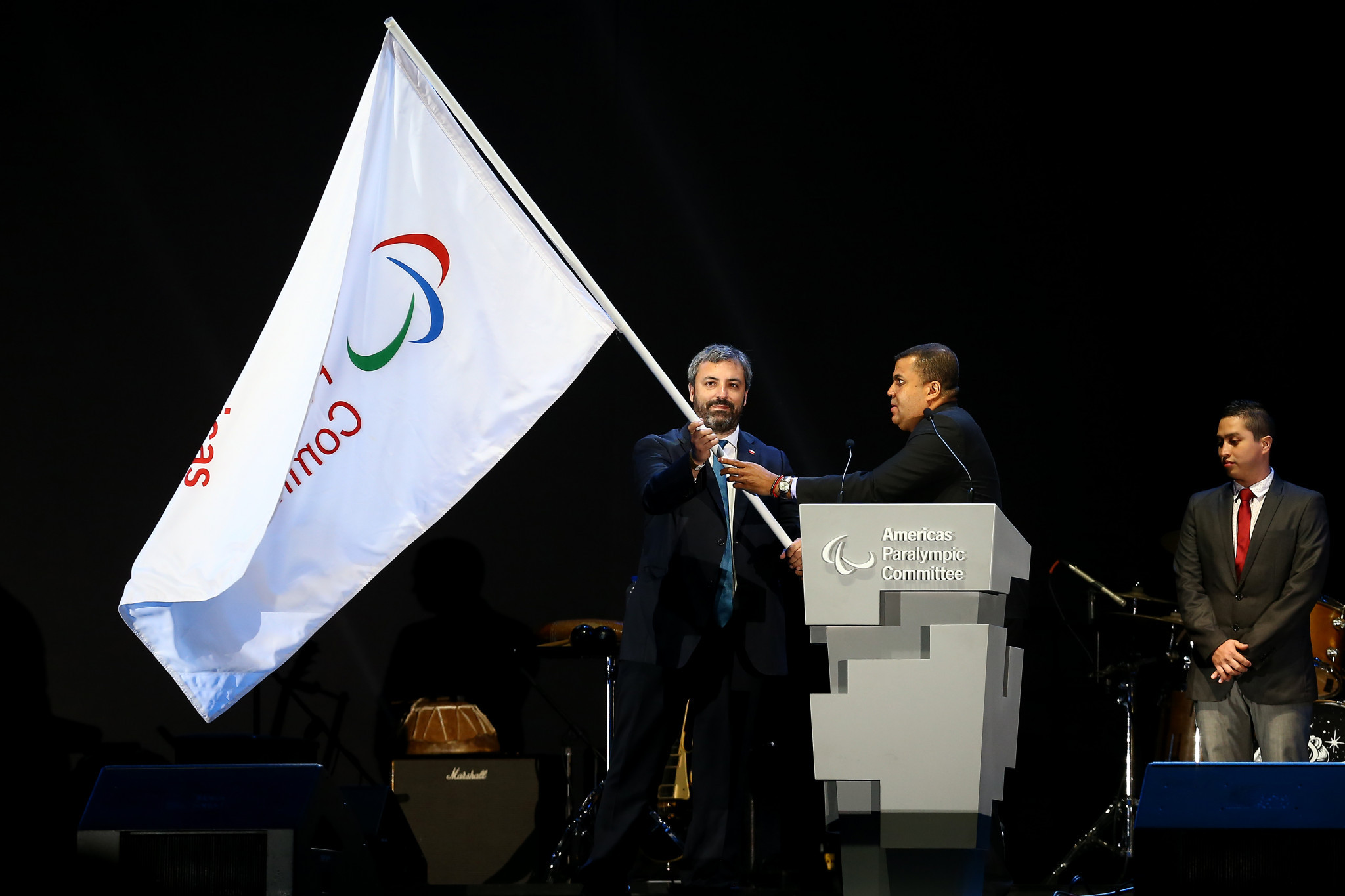 The Americas Paralympic Committee flag was handed to Chilean sports undersecretary Andres Otero Klein, a representative from Santiago 2023 ©Getty Images