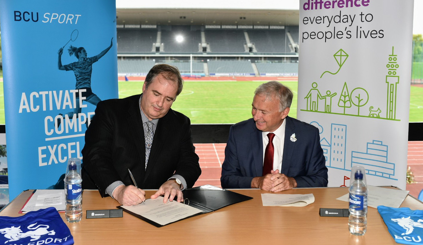 Birmingham City University vice-chancellor Philip Plowden, left, and Birmingham City Council leader Ian Ward, right, signed the deal that will see Alexander Stadium leave a major legacy after the Commonwealth Games ©Nick Robinson - Birmingham City University
