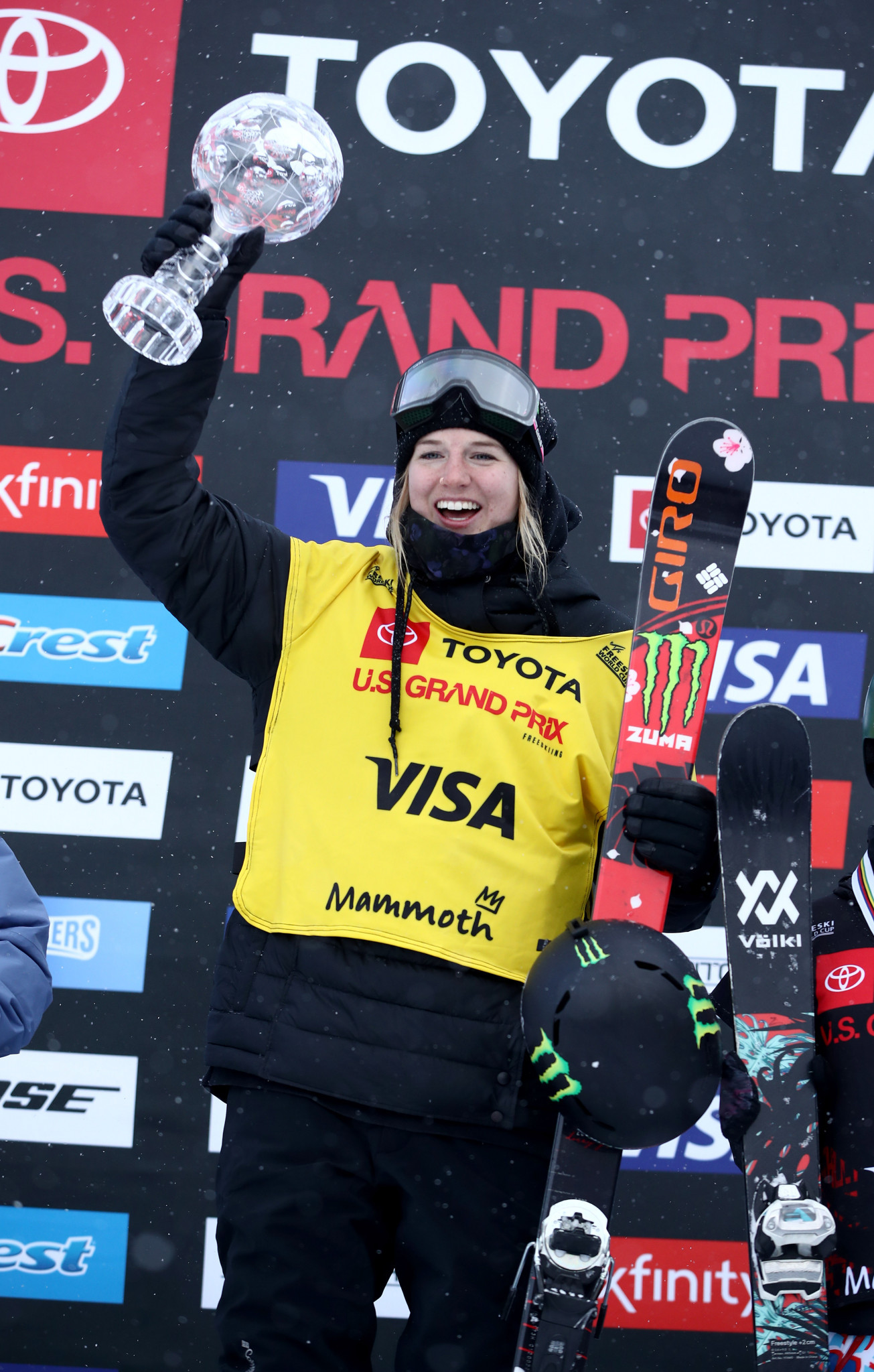 Cassie Sharpe of Canada celebrates on the podium after receiving the globe for being the overall champion for the 2018 season ©Getty Images