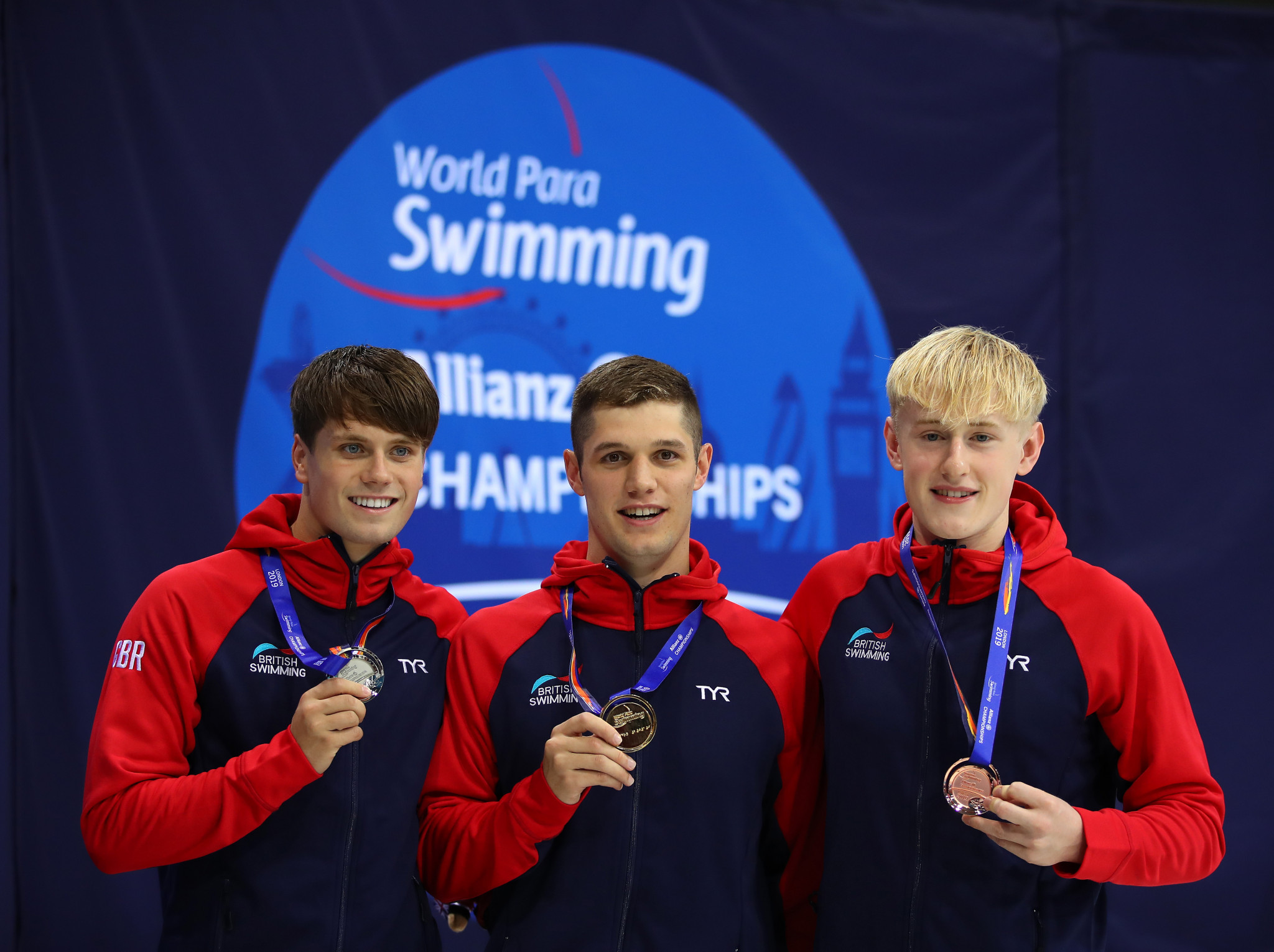 Reece Dunn, centre, led home a British podium sweep in the men's S14 200m freestyle final in London ©Getty Images
