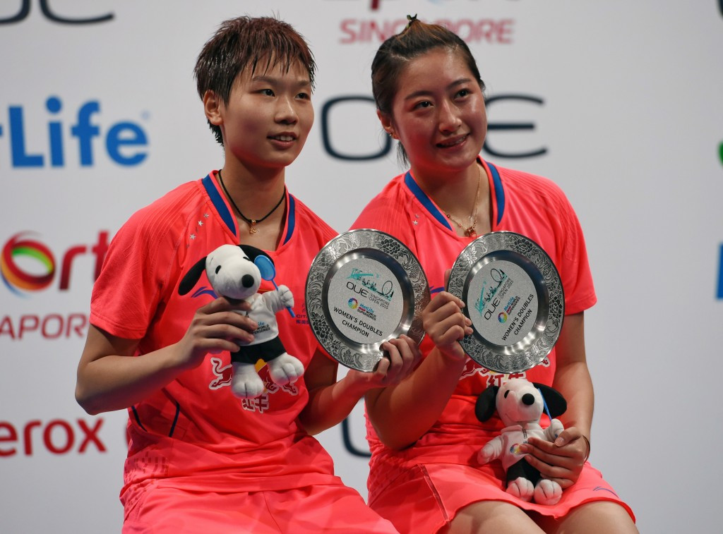 Yu Xiaohan (right) pictured after winning the Singapore Open title in April ©Getty Images