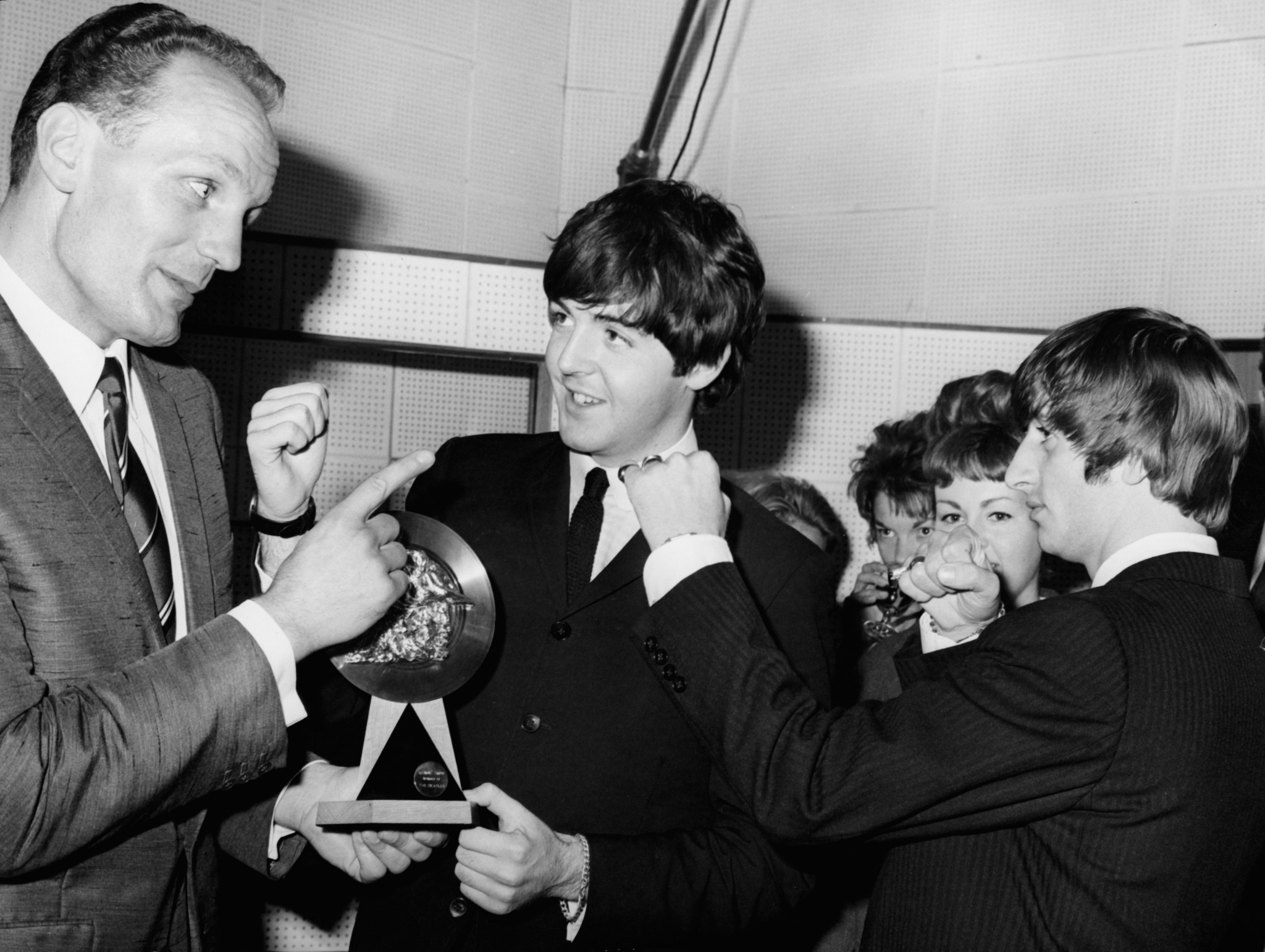Our 'Enery, pictured above with Paul McCartney and Ringo Starr, was a hugely popular figure ©Getty Images