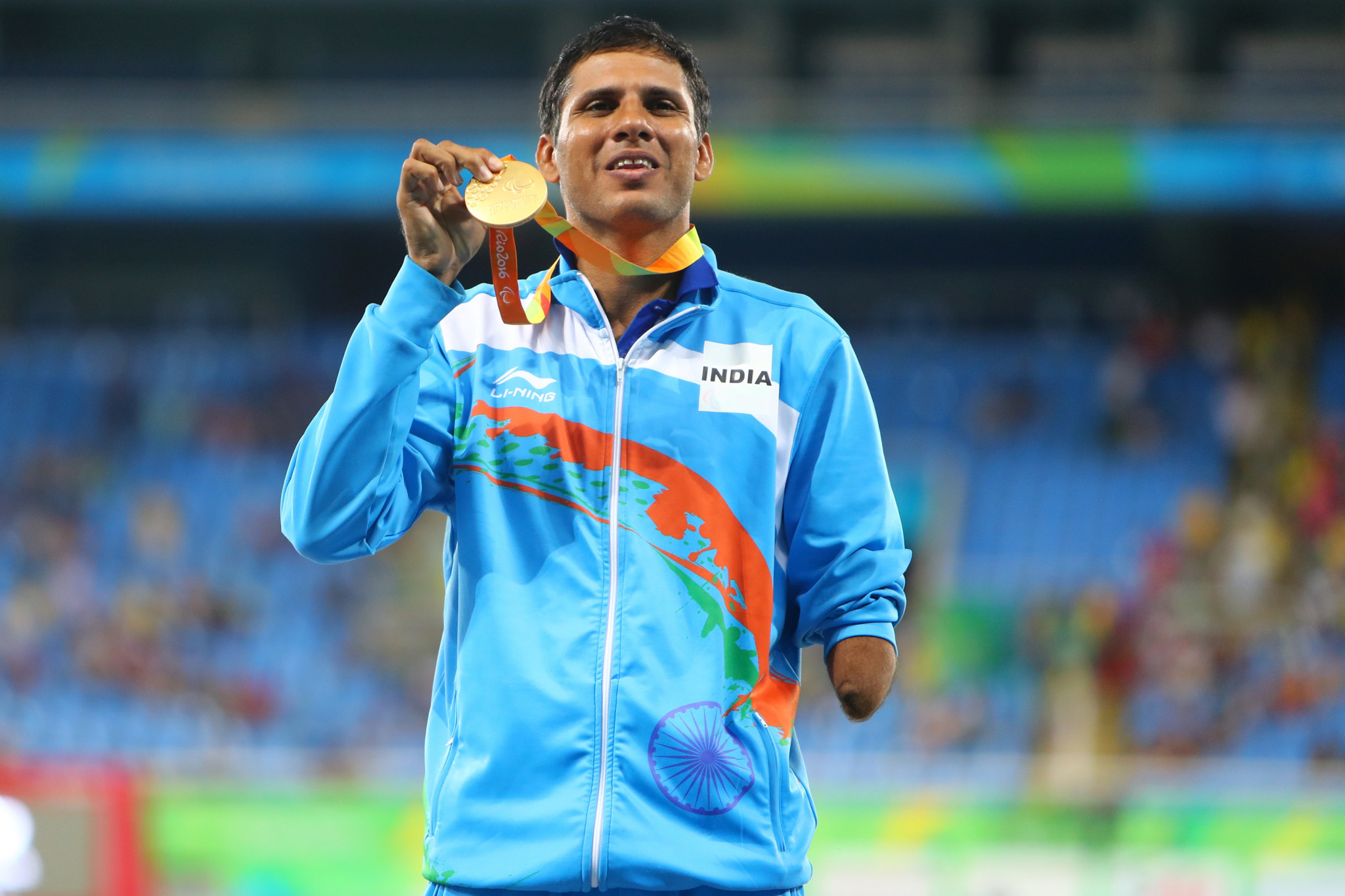 Devendra Jhajharia of India poses on the podium at the Rio 2016 Paralympic Games after winning the men's F46 javelin gold medal ©Getty Images