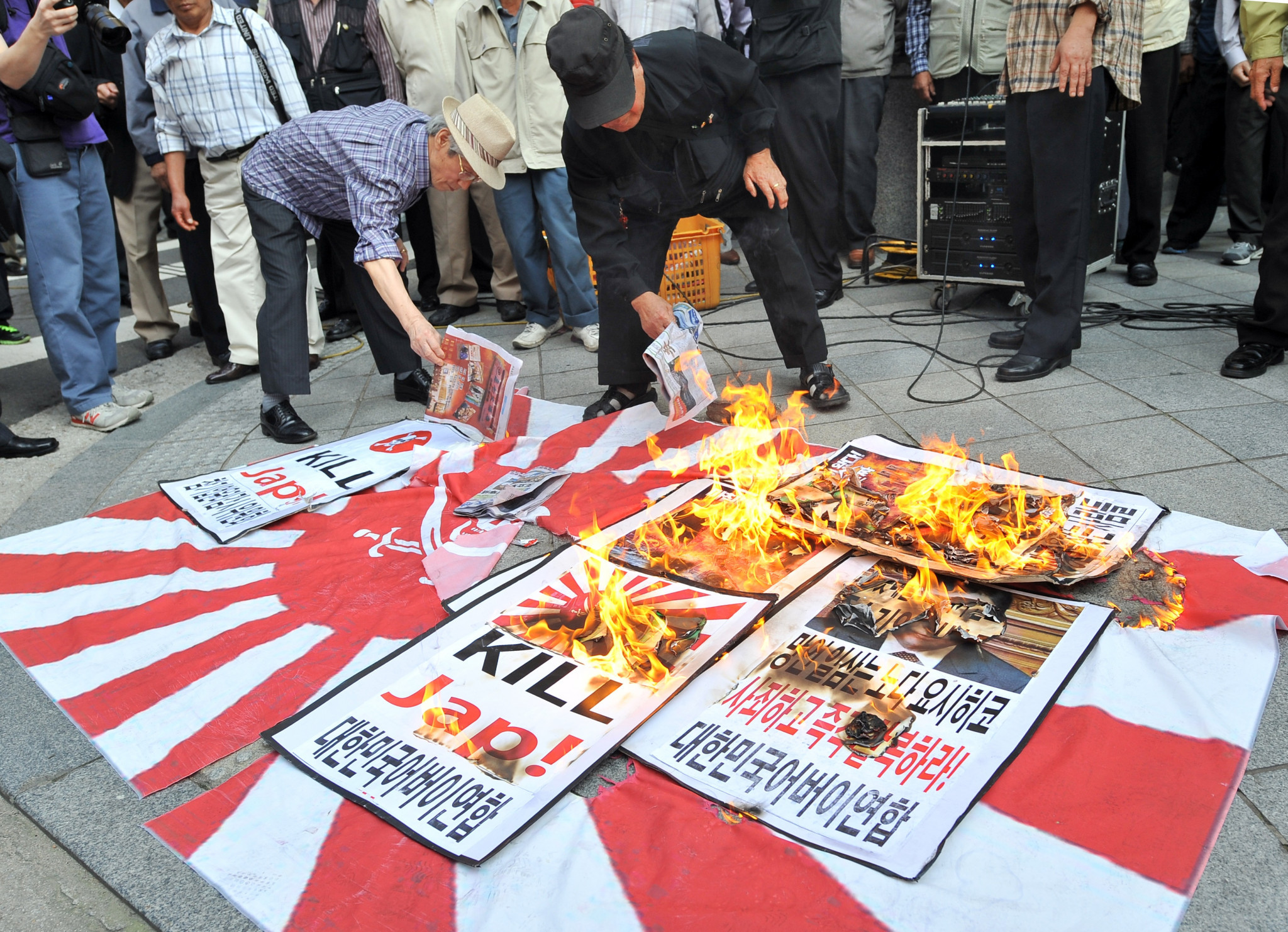 South Korean protestors set fire to a Rising Sun Flag at a rally ©Getty Images