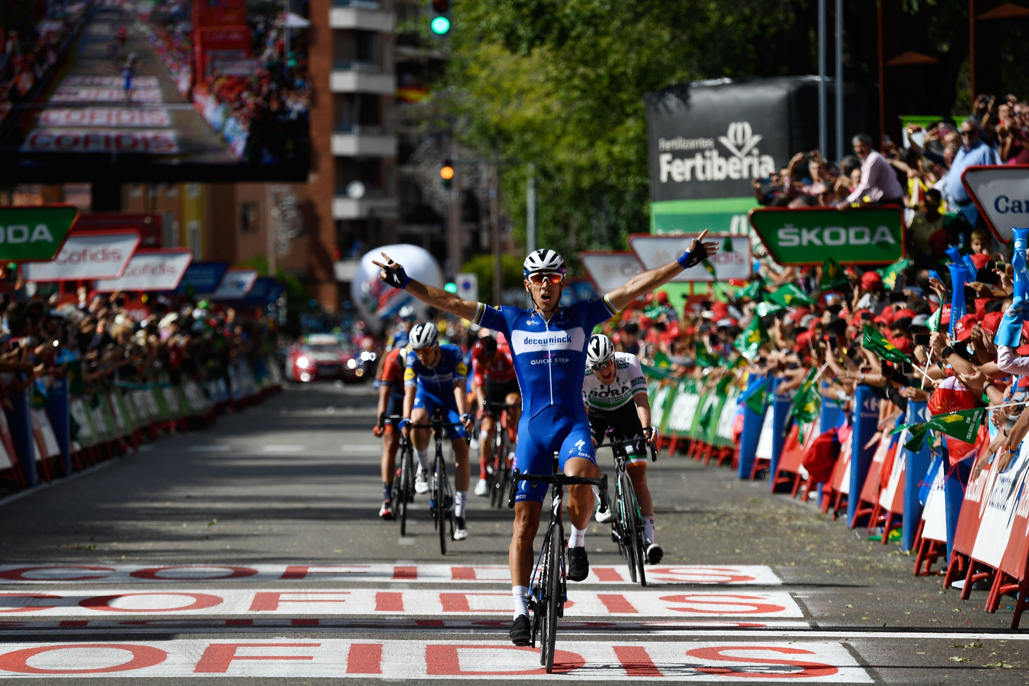 Gilbert sprints to stage 17 victory as Roglič retains Vuelta a España lead