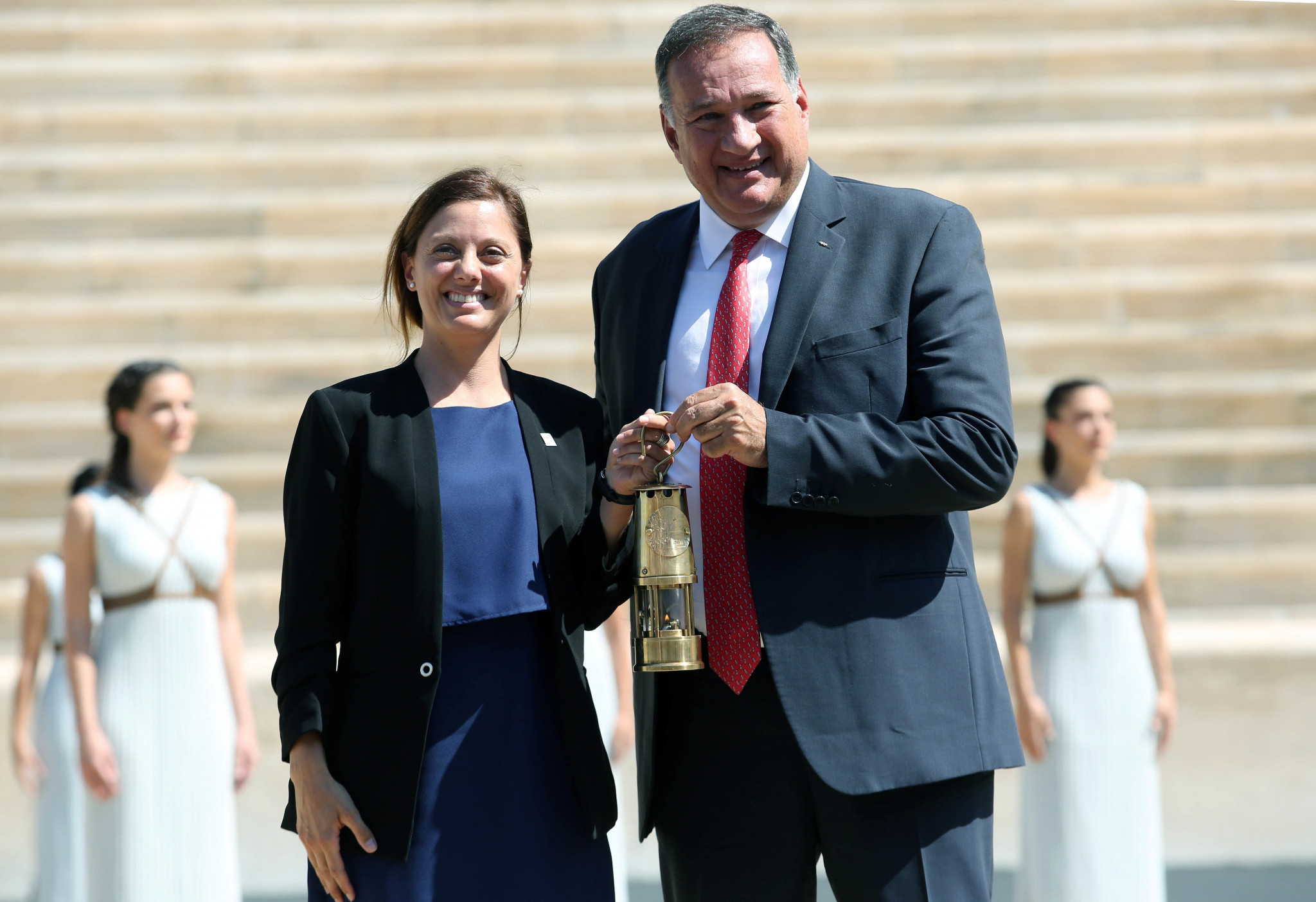 Lausanne 2020 President Virginie Faivre received the flame from Hellenic Olympic Committee President Spyros Capralos ©Hellenic Olympic Committee