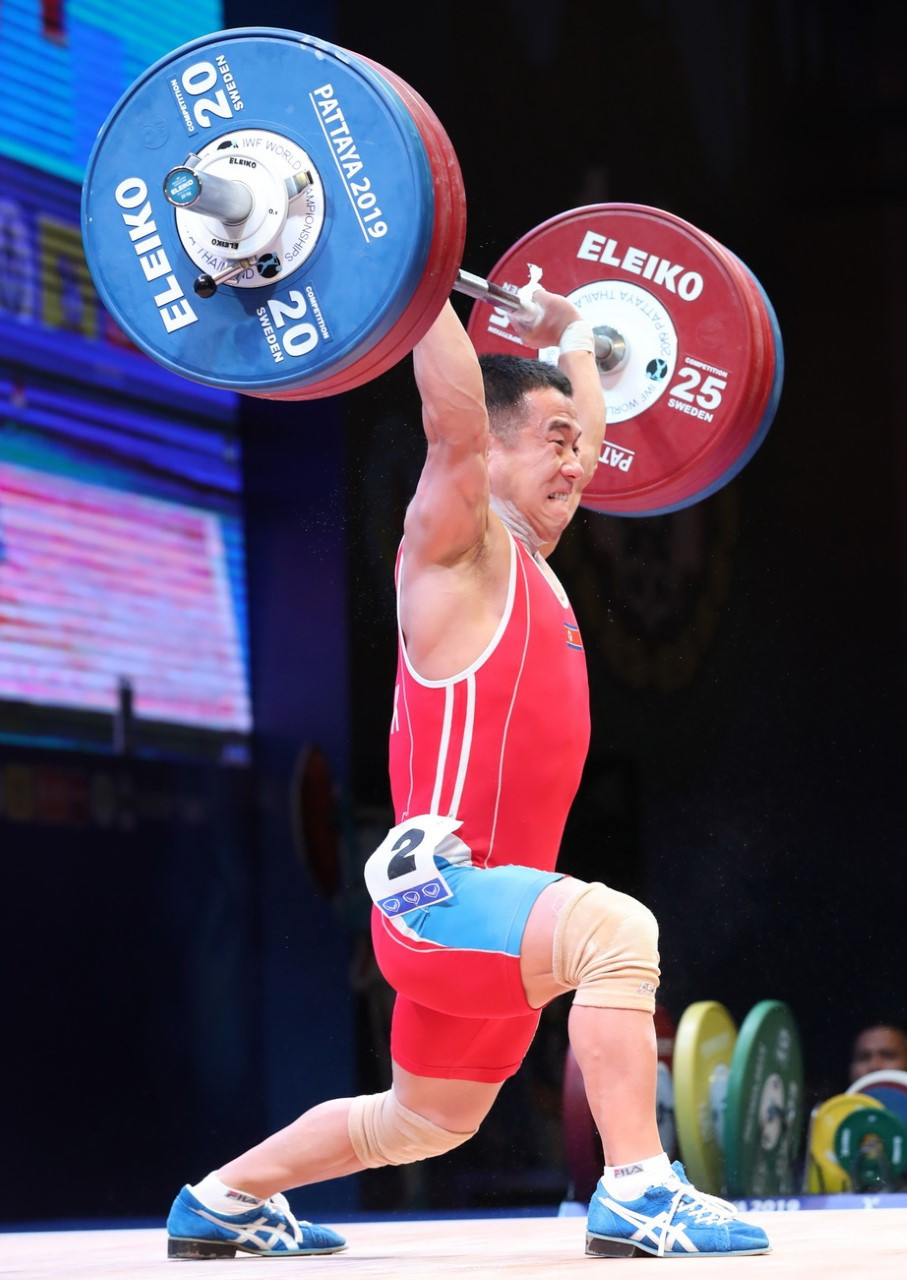 North Korea's Om Yun Chol was the stand-out performer on the first day of competition, breaking the men's 55 kilograms clean and jerk and total world records on his way to retaining his three gold medals ©IWF