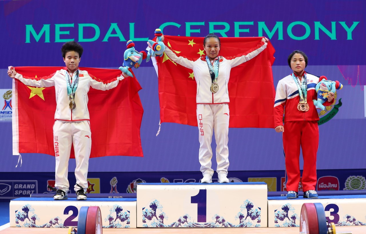 China's Jiang Huihua and Hou Zhihui were joined on the women's 49 kilograms total podium by North Korea's Ri Song Gum ©IWF