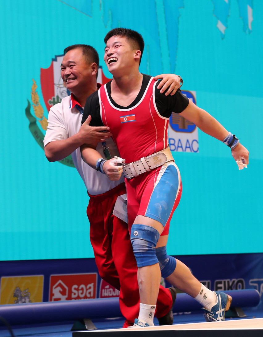 Rounding off the total podium was North Korea's Pak Jong Ju, who broke the world record in the clean and jerk with a lift of 188kg to finish on 330kg overall ©IWF