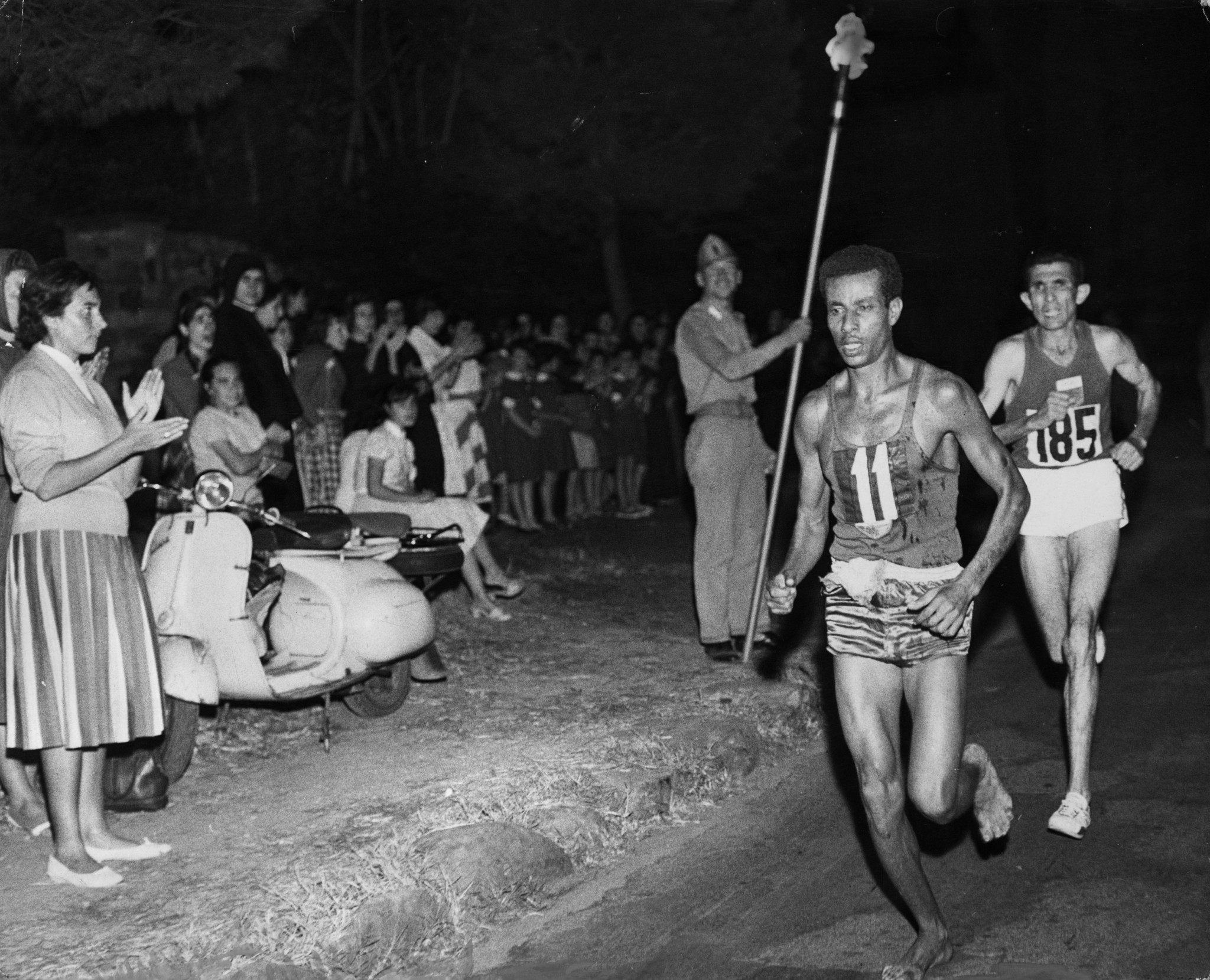 Abebe Bikila of Ethiopia en-route to a barefoot, torch-lit marathon victory at the 1960 Olympics in Rome ©Getty Images