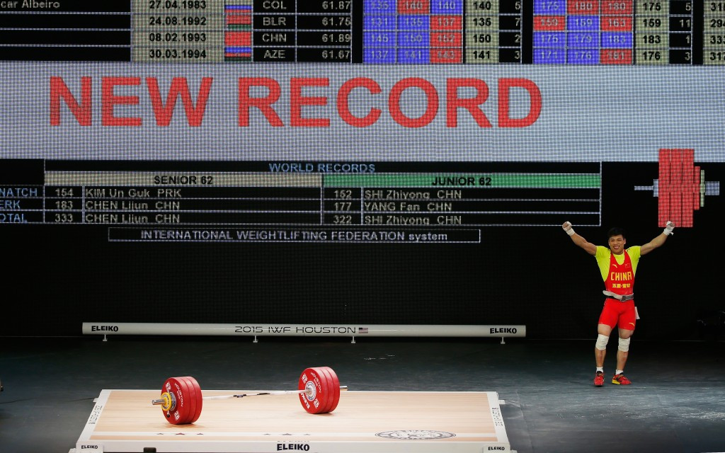 China's Chen breaks two world records on way to double gold at 2015 World Weightlifting Championships