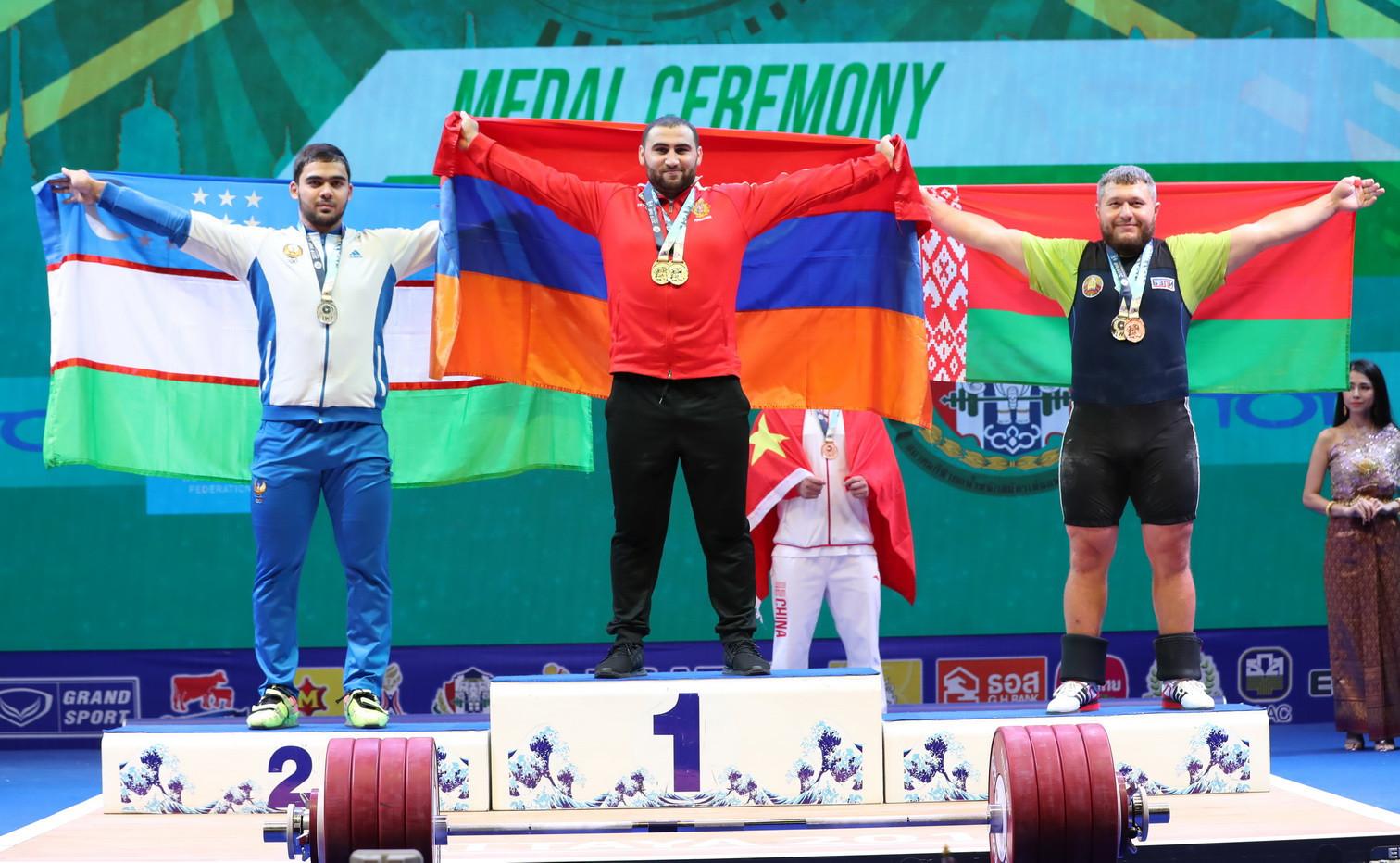 Uzbekistan's Akbar Djuraev, left, joined Martirosyan and Aramnau on the clean and jerk podium ©IWF