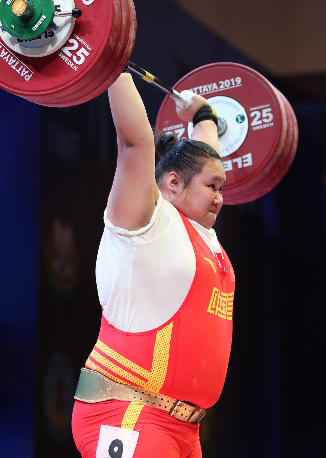 The 19-year-old claimed a hat-trick of gold medals before breaking the clean and jerk and total world records ©IWF