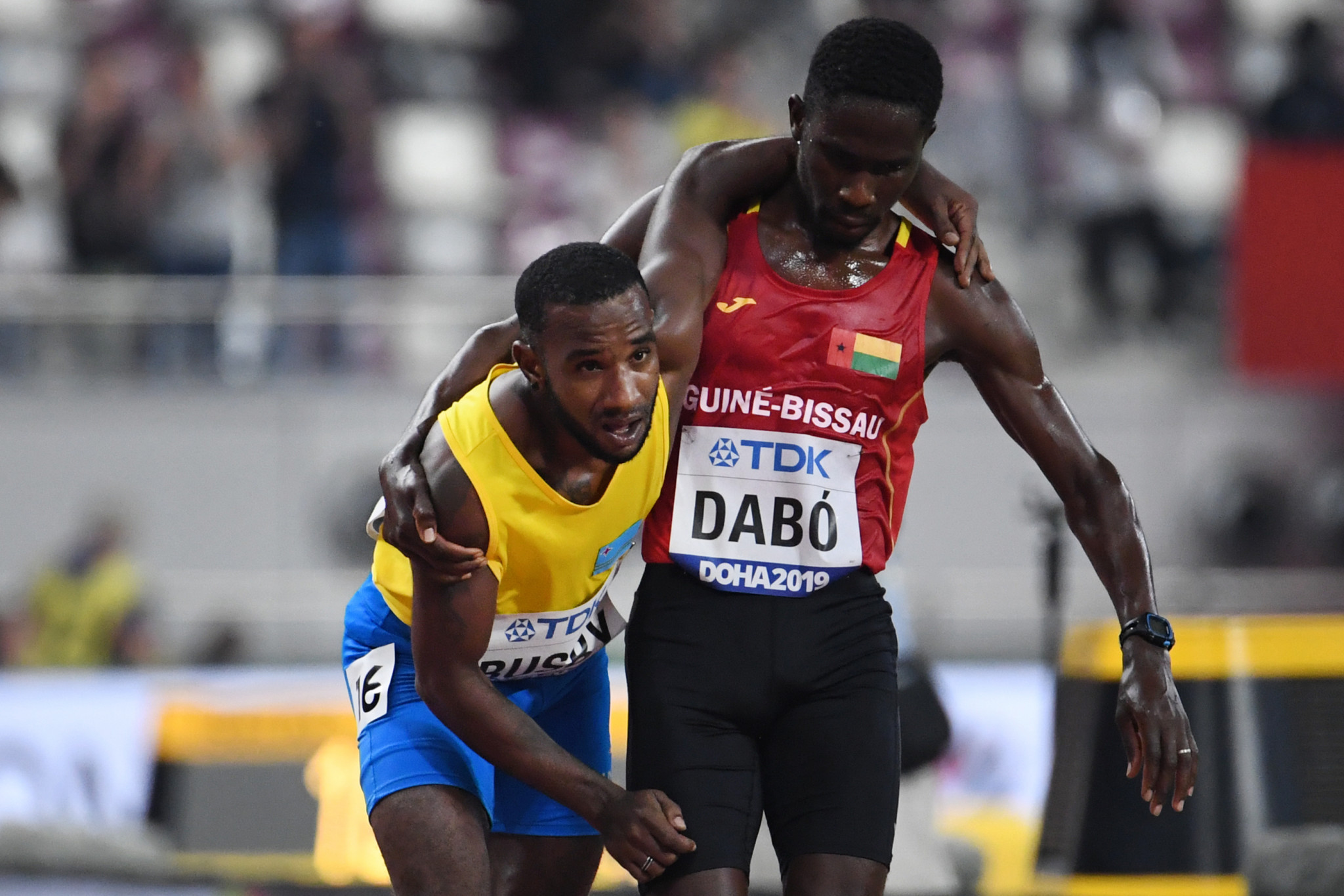 Guinea-Bissau's Braima Suncar Dabo helped stricken rival, Jonathan Busby of Aruba, cross the finishing line in the 5,000 metres on the opening day of the IAAF World Championships in Doha ©Getty Images