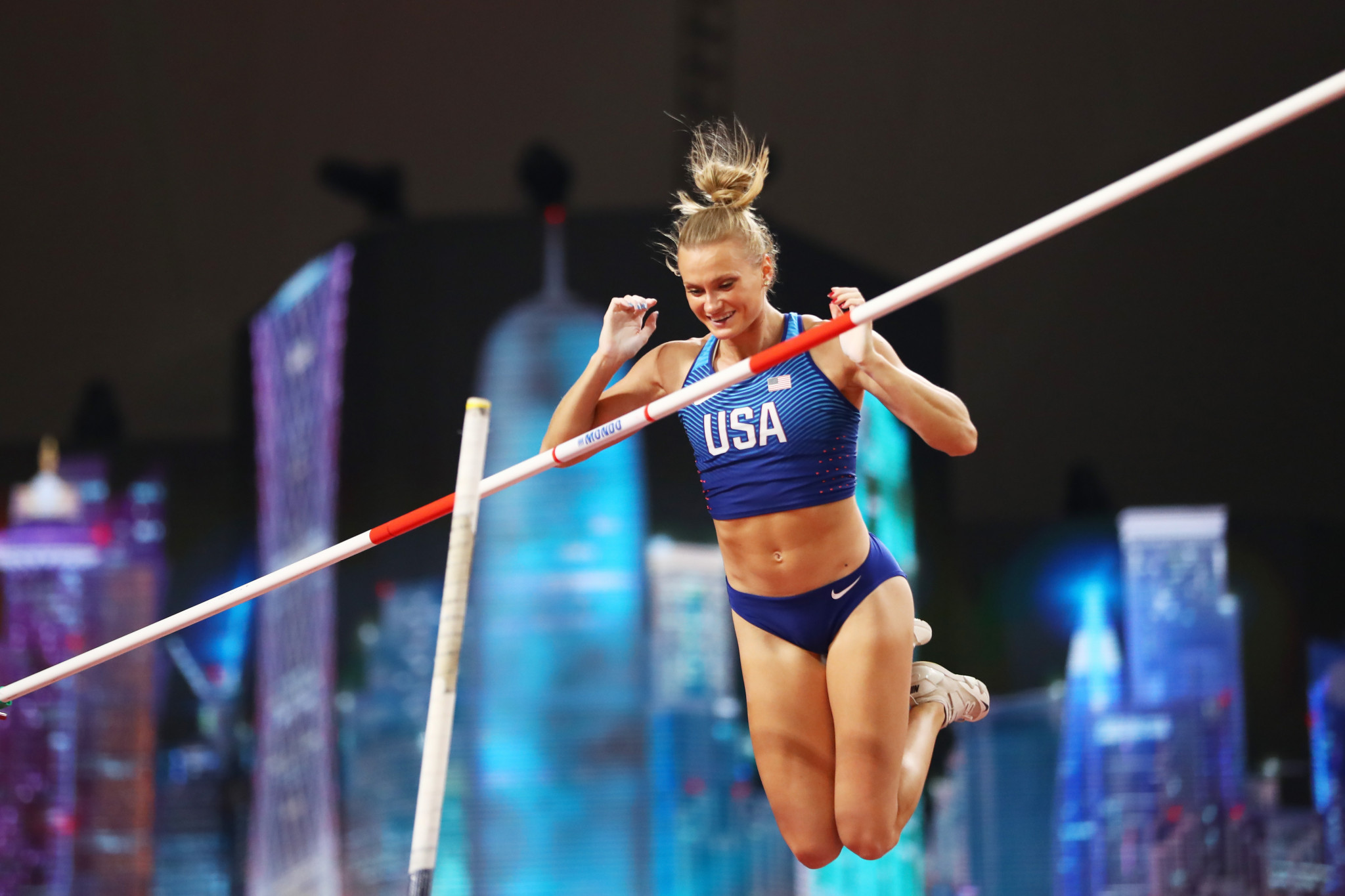 Katie Nageotte of the United States competes in the qualifying competition for the women's pole vault with the Doha skyline behind her ©Getty Images