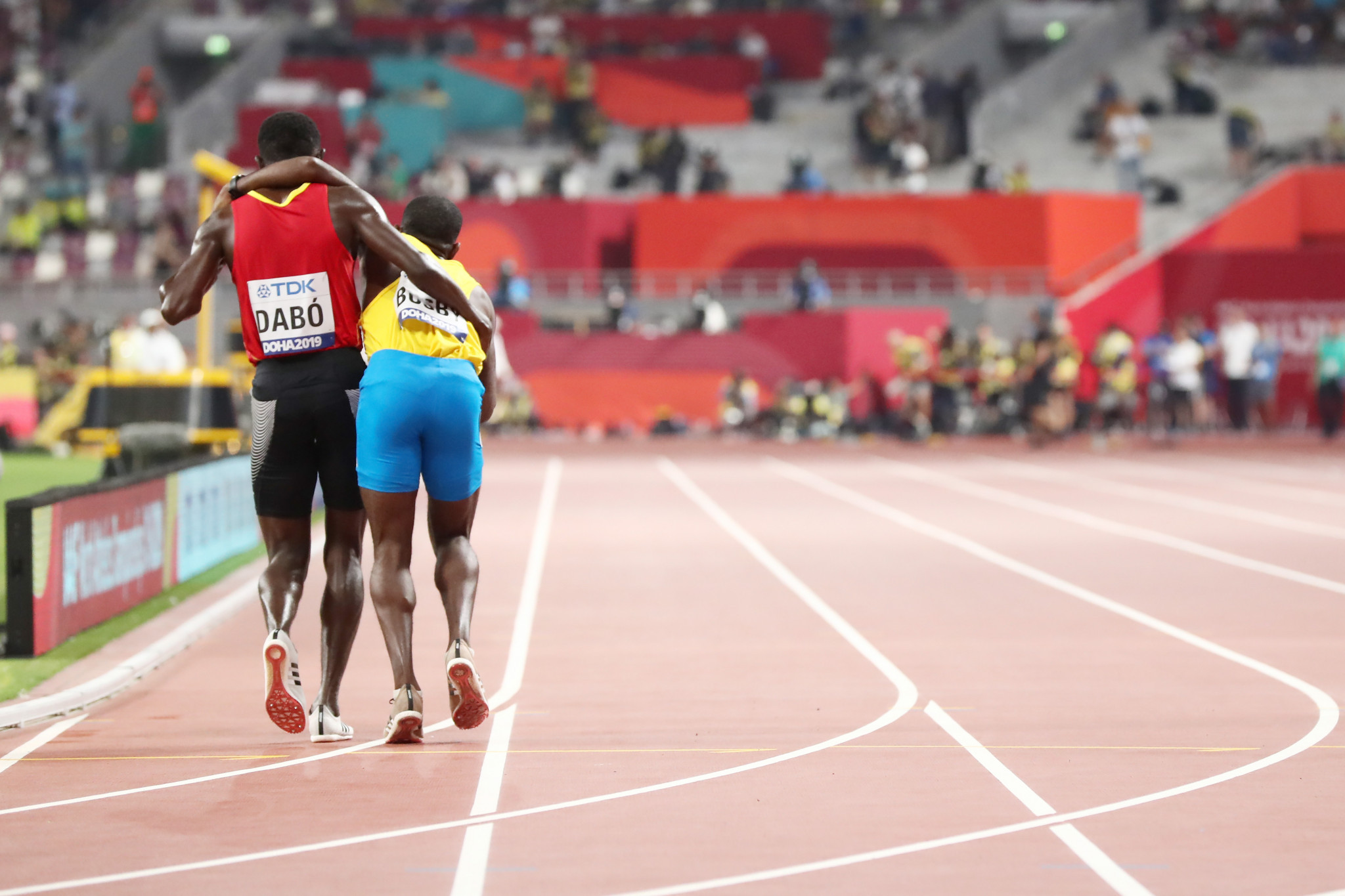 Guinea-Bissau's Braima Suncar Dabo stopped near the end of his 5,000m heat to help Aruba's Jonathan Busby, who had collapsed with exhaustion ©Getty Images