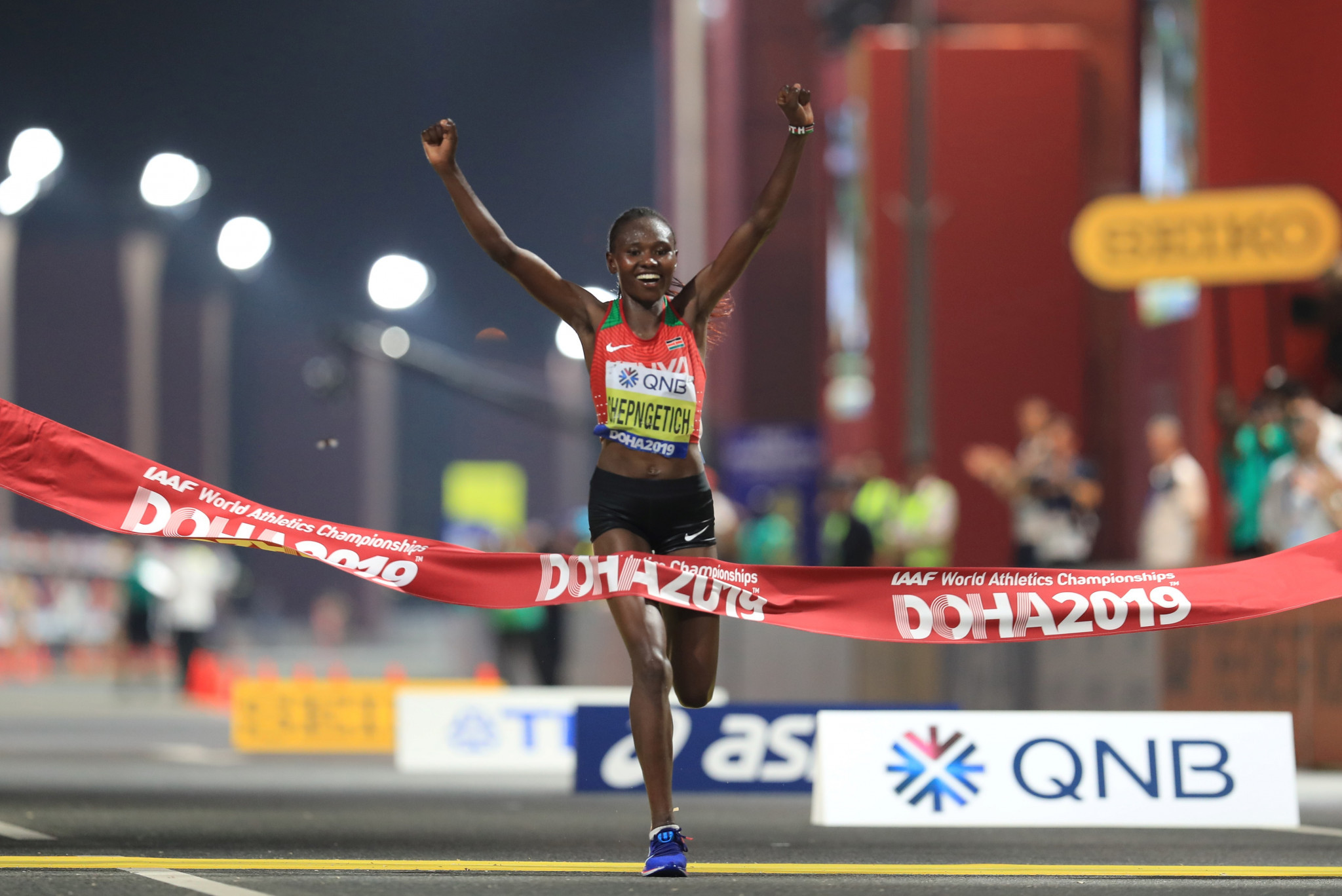 Kenya's Ruth Chepngetich celebrates winning the first gold medal of the IAAF World Championships in Doha ©Getty Images