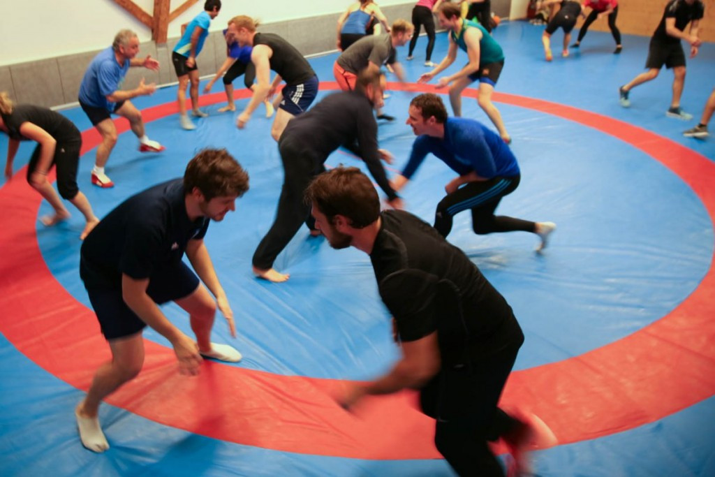 IOC staff visit United World Wrestling headquarters to watch demonstration of sport