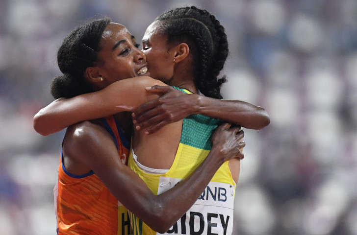 Sifan Hassan of The Netherlands embraces the Ethiopian who chased her home in the women's 10,000m, Letesenbet Gidey, but in the end was outclassed by a runner set to chase a golden Doha double ©Getty Images