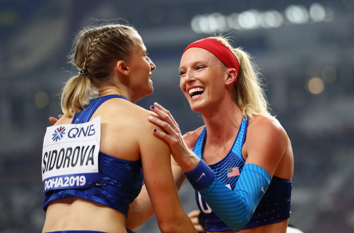 Anzhelika Sidorova is congratulated by silver medallist Sandi Morris of the United States after a dramatic win in the pole vault with a clearance of 4.95m ©Getty Images