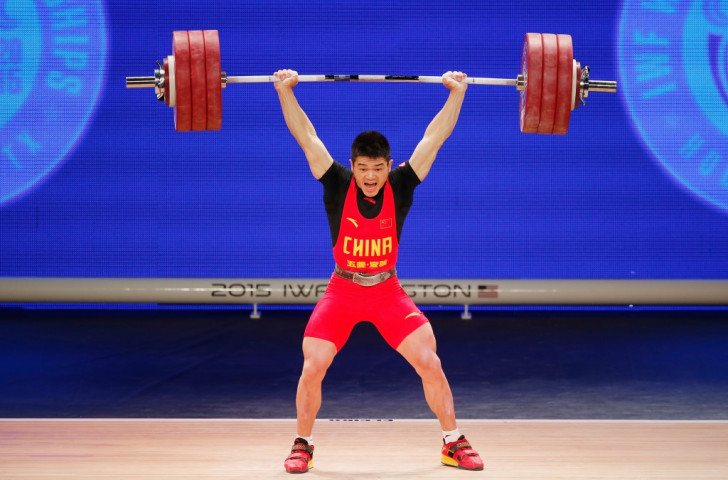 China's Zhiyong Shi claimed the men's 69kg clean and jerk and overall titles
