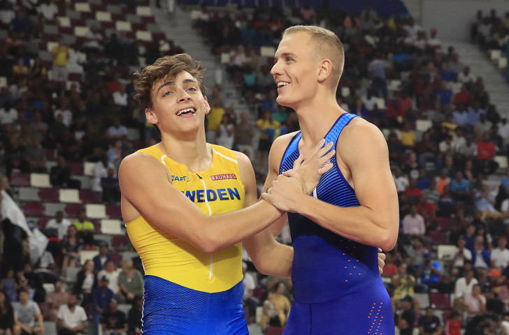 Sam Kendricks of the United States, right, retained his world pole vault title after a monumental competition against Sweden's 19-year-old Armand Duplantis in Doha ©Getty Images