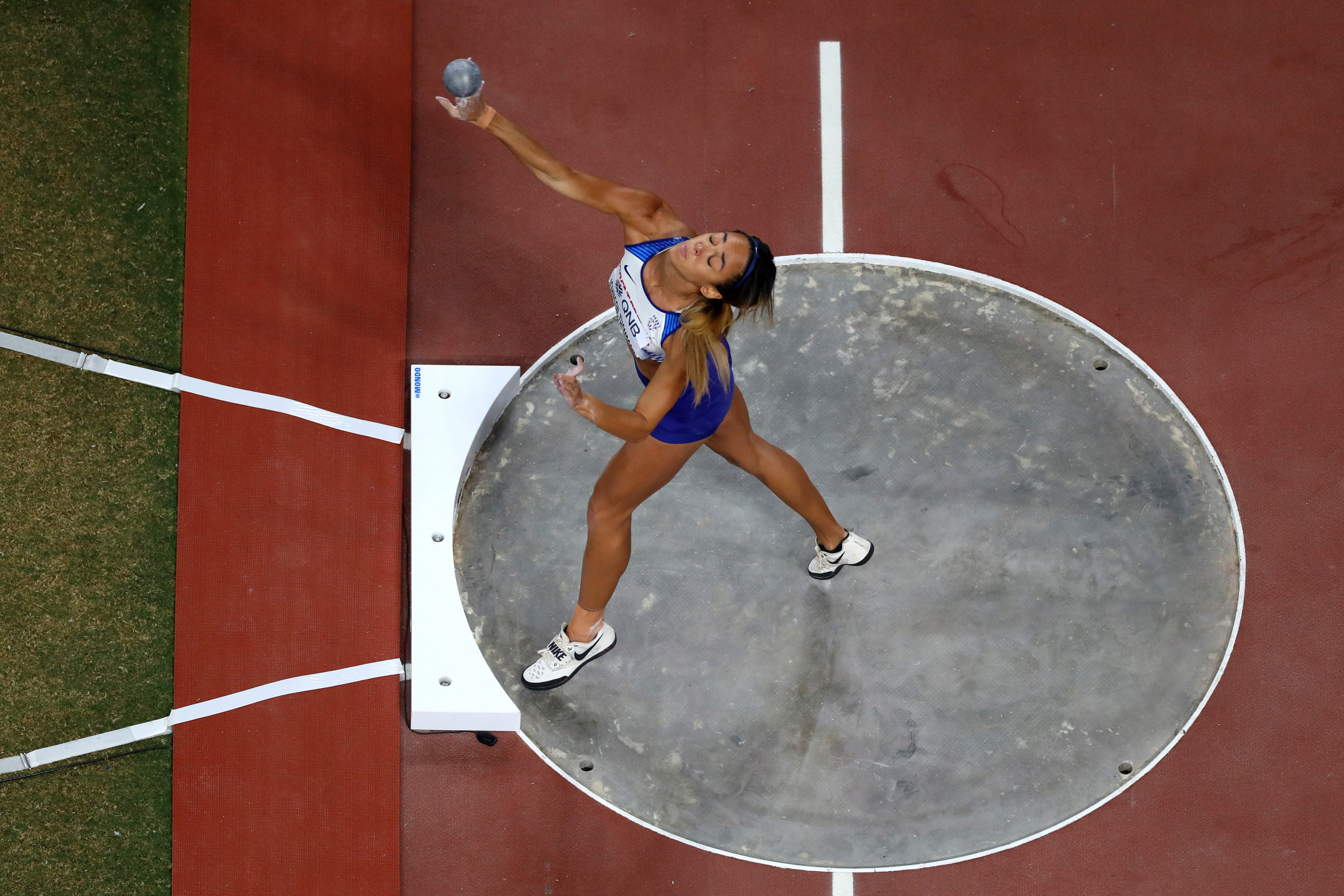 Katarina Johnson-Thompson of Great Britain competes in the women's heptathlon shot put as she finished the opening day in the lead ©Getty Images
