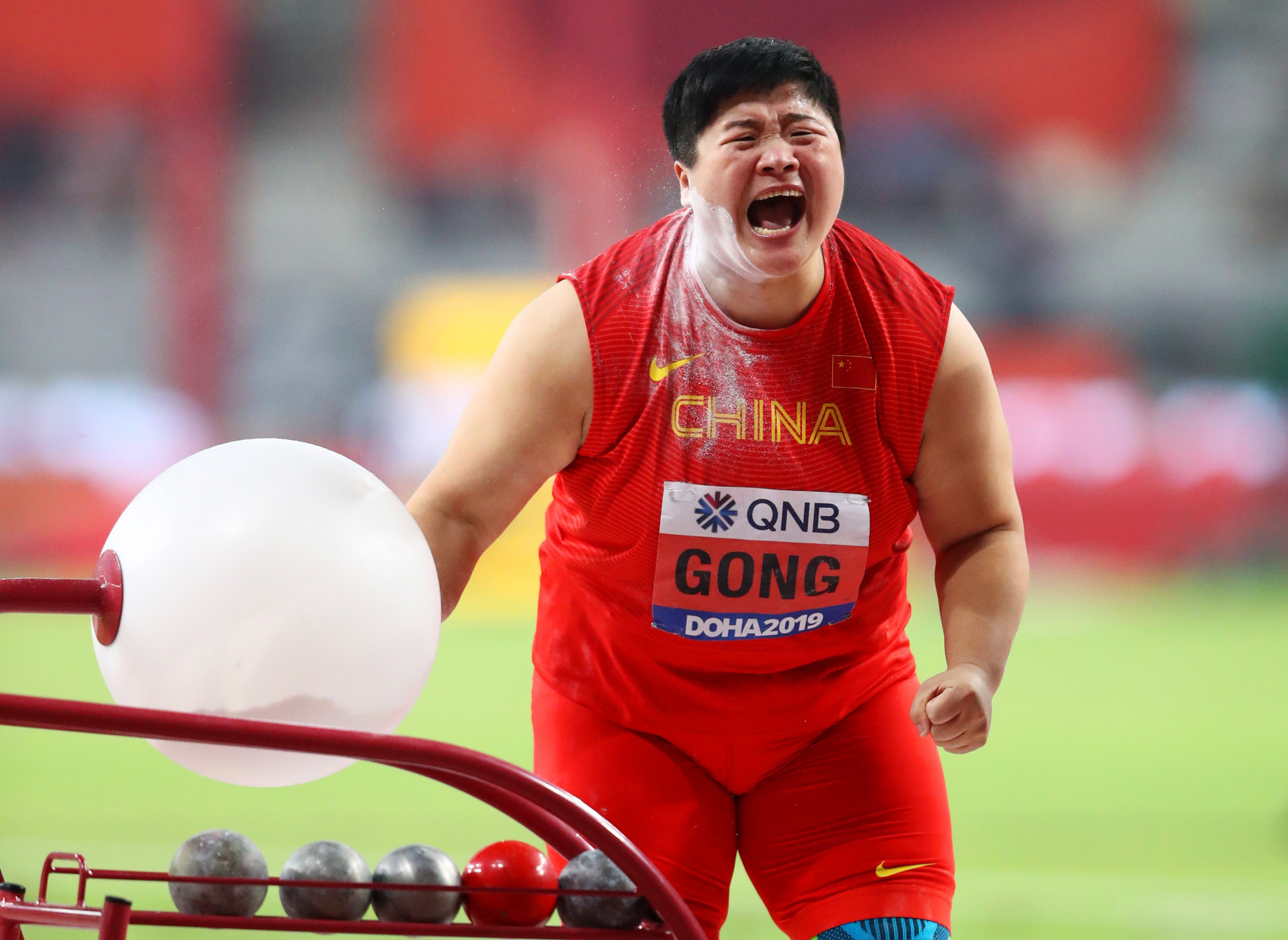 Lijiao Gong of China celebrates winning the women's shot put - her second consecutive gold and the sixth time time in a row she has won a medal at the IAAF World Championships ©Getty Images