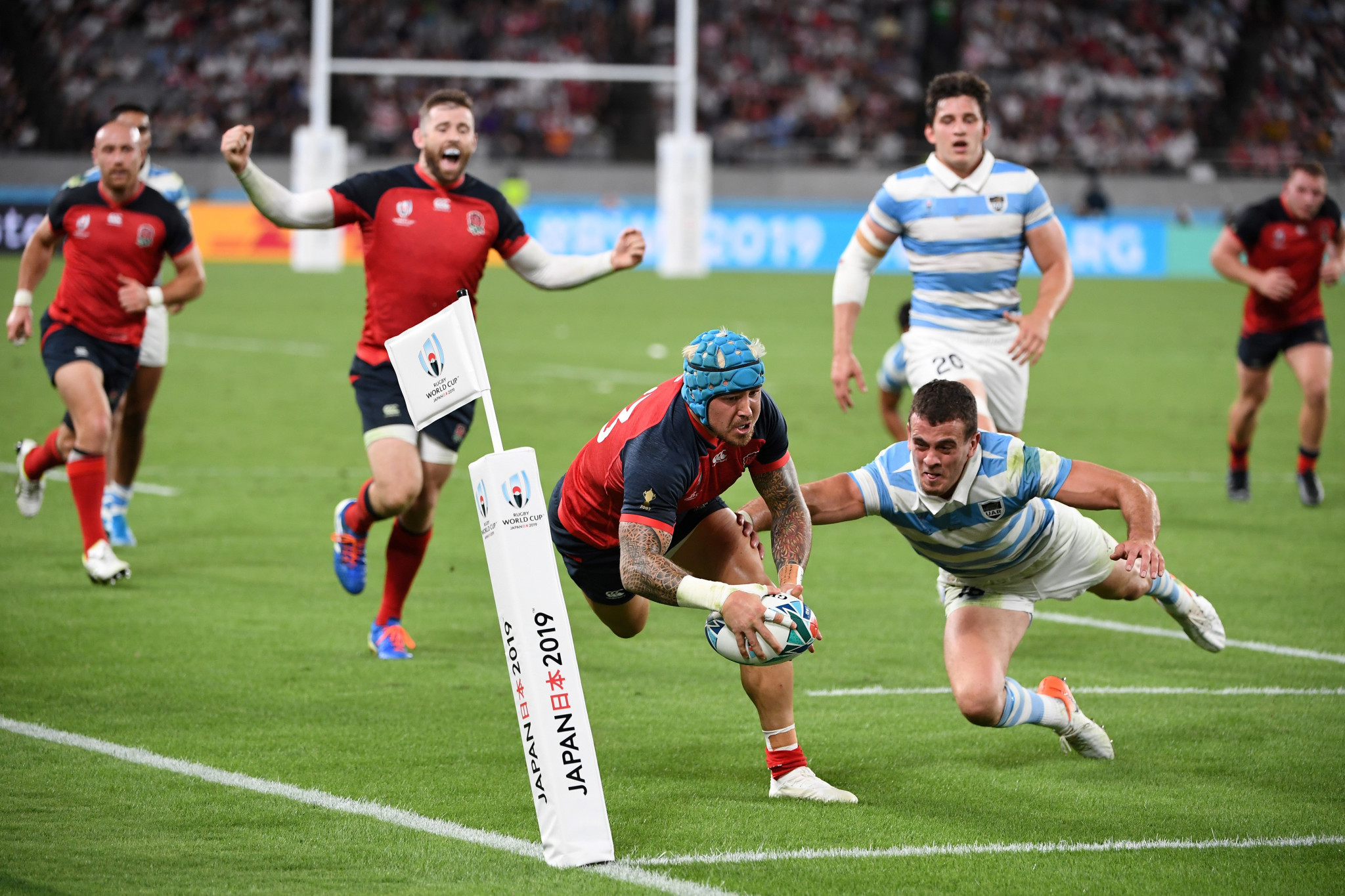 England scrap to Argentina win, while Japan dare to dream