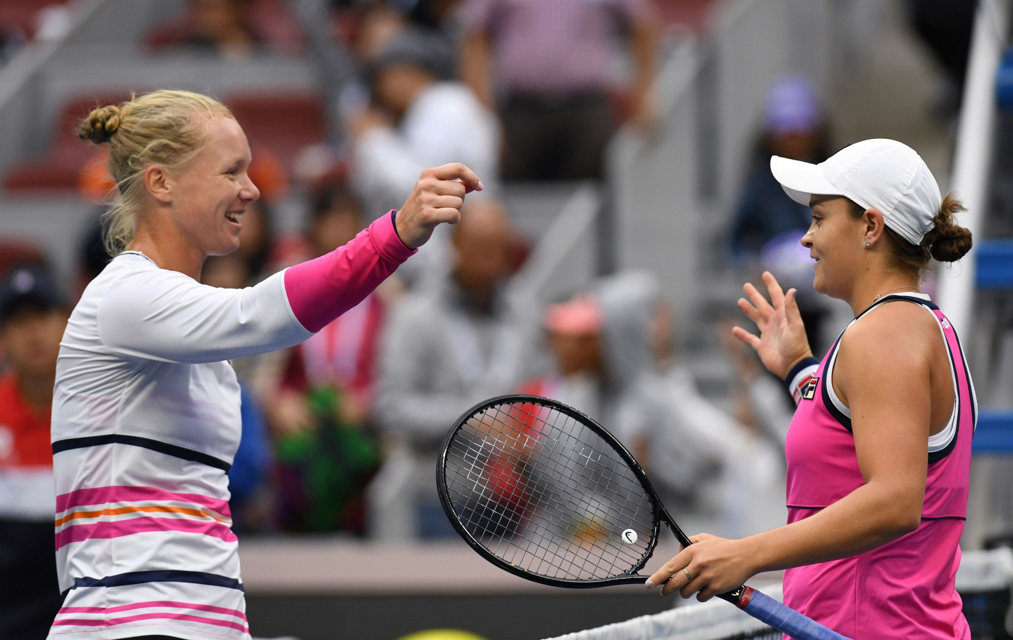 Ashleigh Barty, right, is congratulated by Kiki Bertens after their epic tussle ©Getty Images