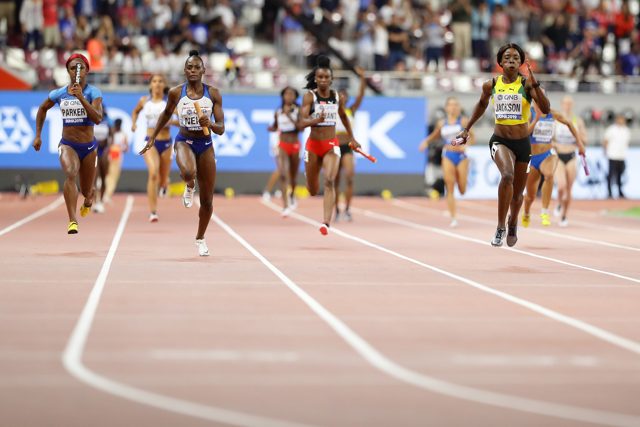 Shericka Jackson of Jamaica, Daryll Neita of Great Britain and Kiara Parker of the US compete in the women's 4x100m relay ©Getty Images