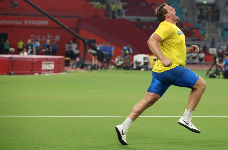 Sweden's Daniel Stahl turns sprinter in celebration of his world discus gold in Doha ©Getty Images