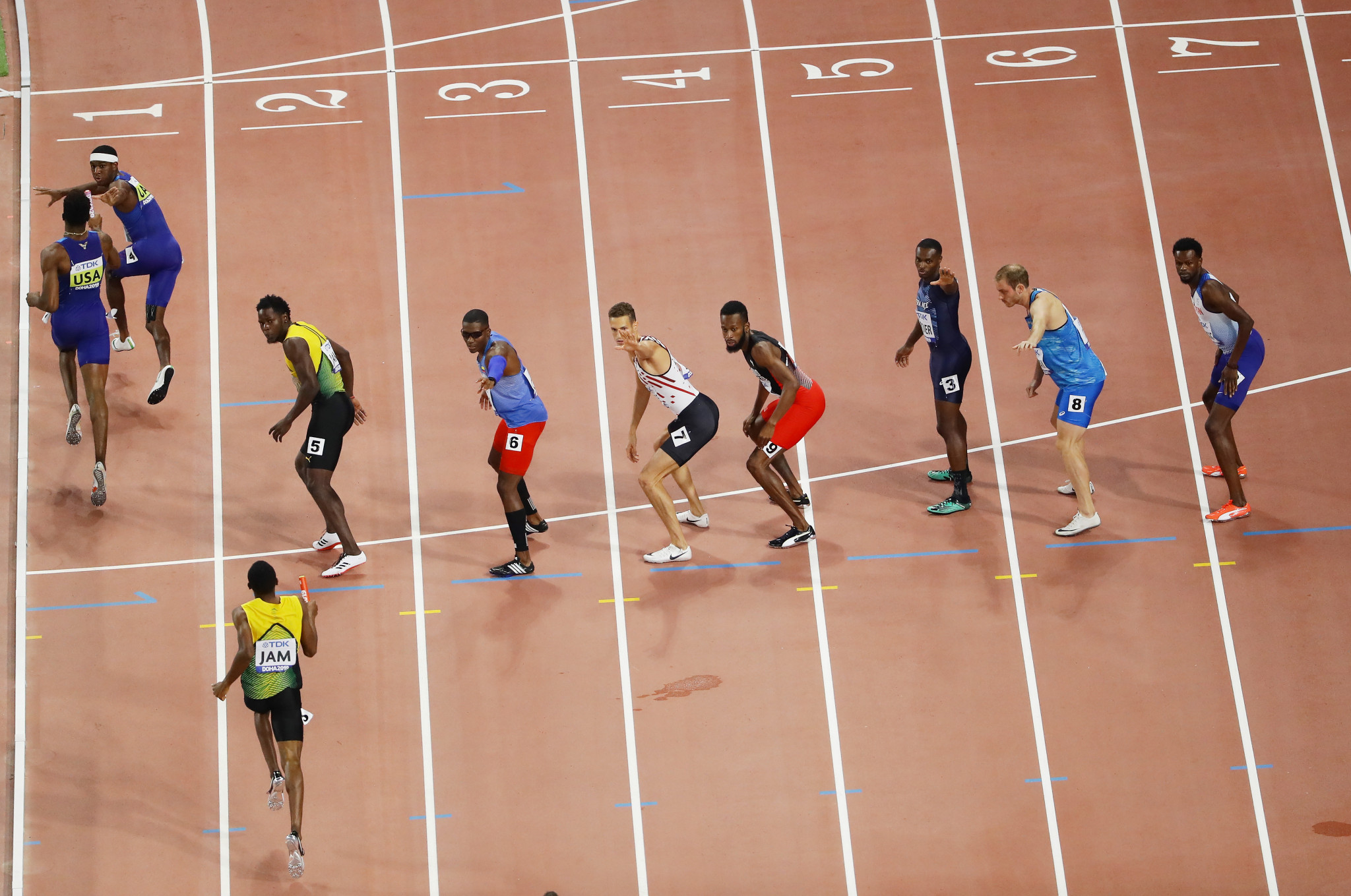 Wilbert London gets the baton from Michael Cherry in the men's 4x400 metres relay final to set the United States on their way to their third gold of the evening as they topped the overall medals table ©Getty Images